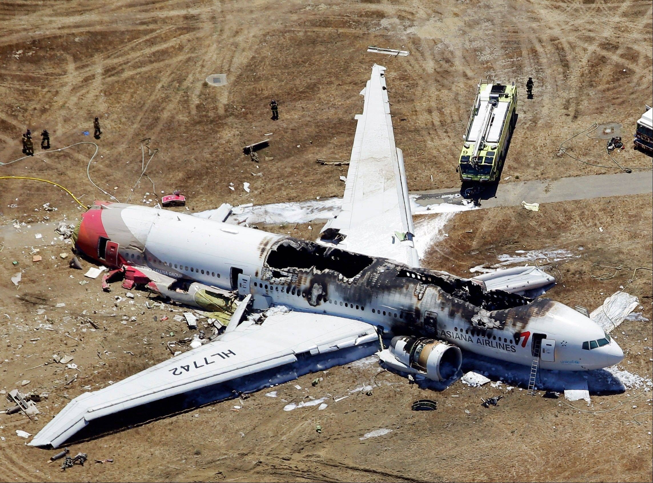 This aerial photo shows the wreckage of the Asiana Flight 214 airplane after it crashed at the San Francisco International Airport in San Francisco, Saturday.