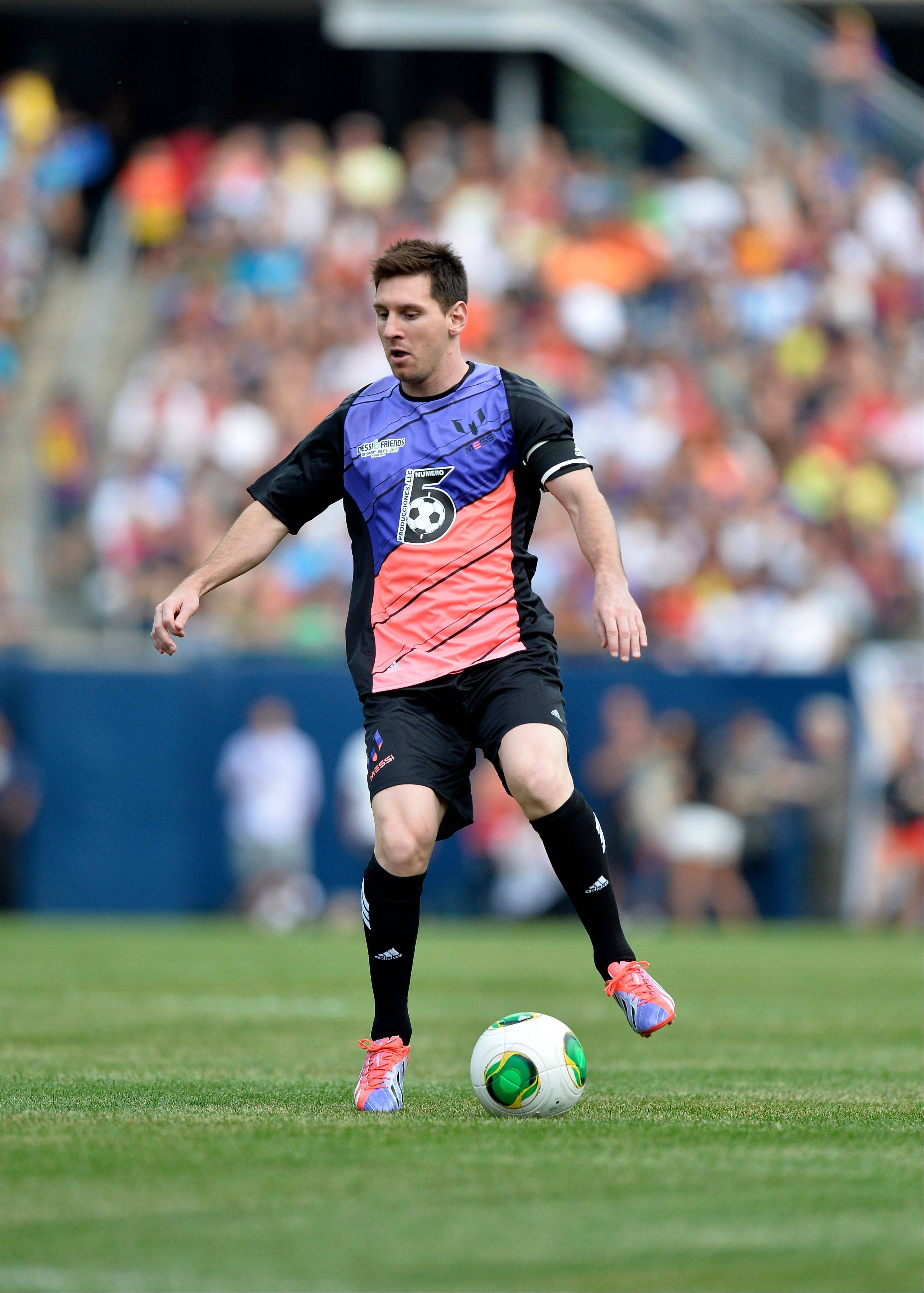 Messi�s Friends� Lionel Messi handles the ball against the Rest of the World during the first half of the Messi and Friends charity soccer exhibition, Saturday, July 6, 2013 in Chicago.