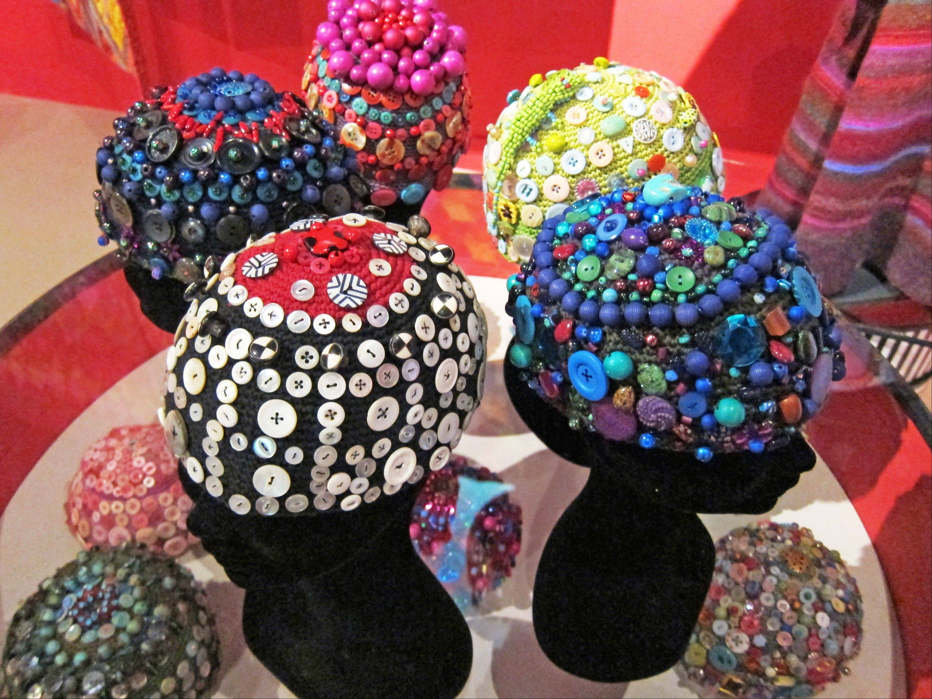"Textile artist Kaffe Fassett's crocheted skull caps, which are embellished with buttons and beads. Dozens of similar caps appeared in the show ""Kaffe Fassett: A Life in Colour"" recently at the Fashion and Textile Museum in London."