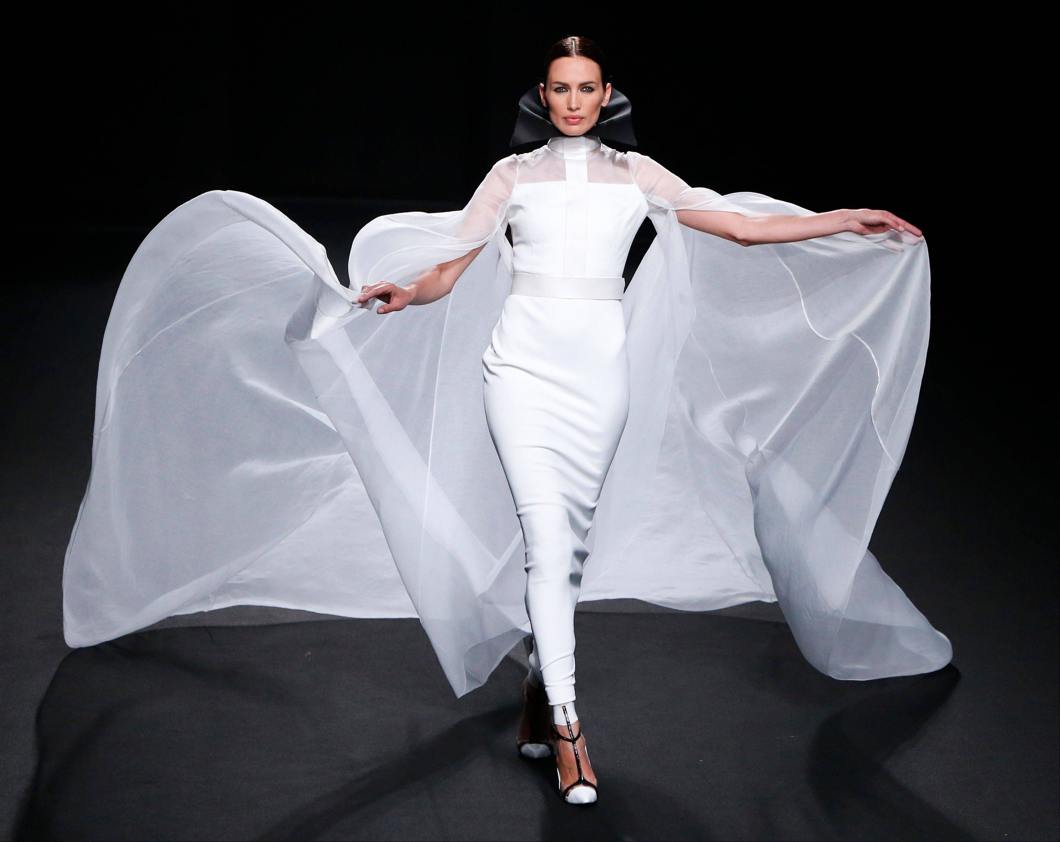 A model wears a creation by French fashion Stephane Rolland's Haute Couture Fall-Winter 2013-2014 collection presented Tuesday, July 2, 2013 in Paris.