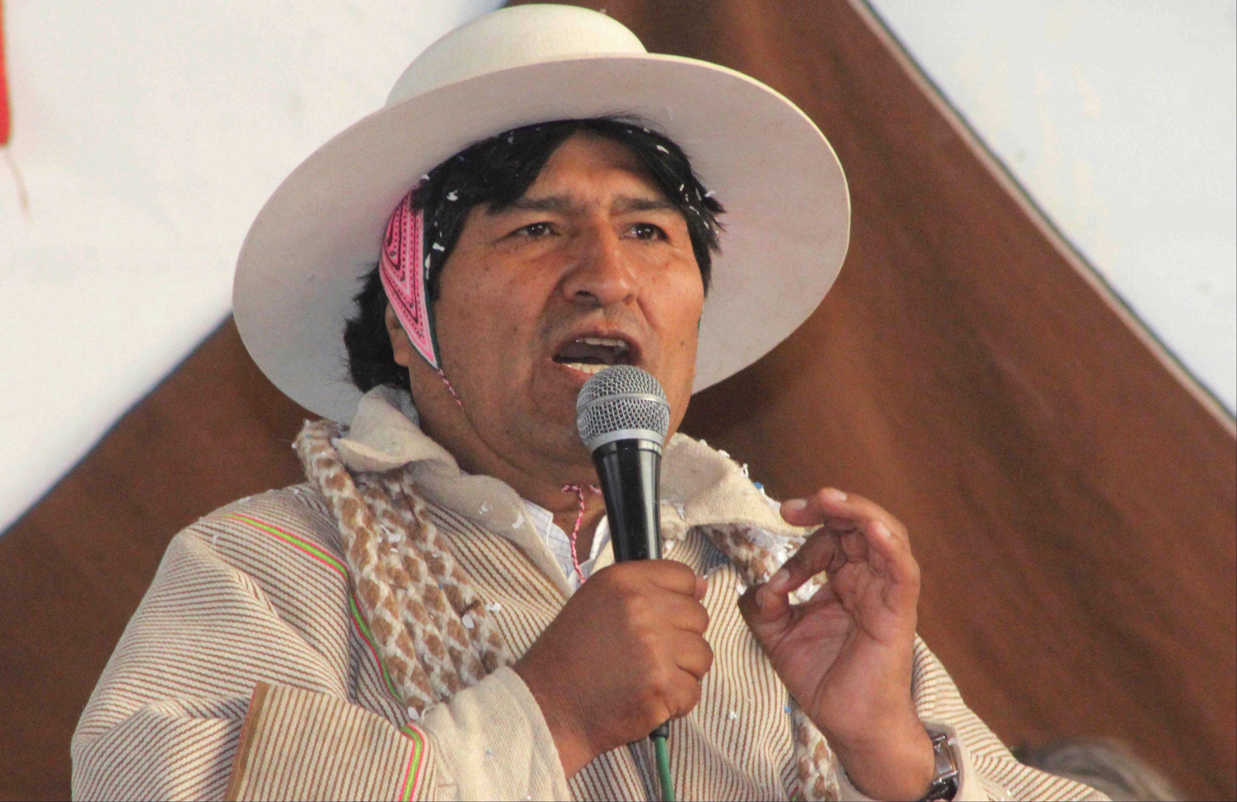 In this photo released by the state news agency, Bolivian Information Agency, Bolivia's President Evo Morales speaks during a meeting with Uru-Chipaya indigenous in Chipaya, Bolivia, Saturday. Morales announced NSA leaker Edward Snowden is welcome in Bolivia.