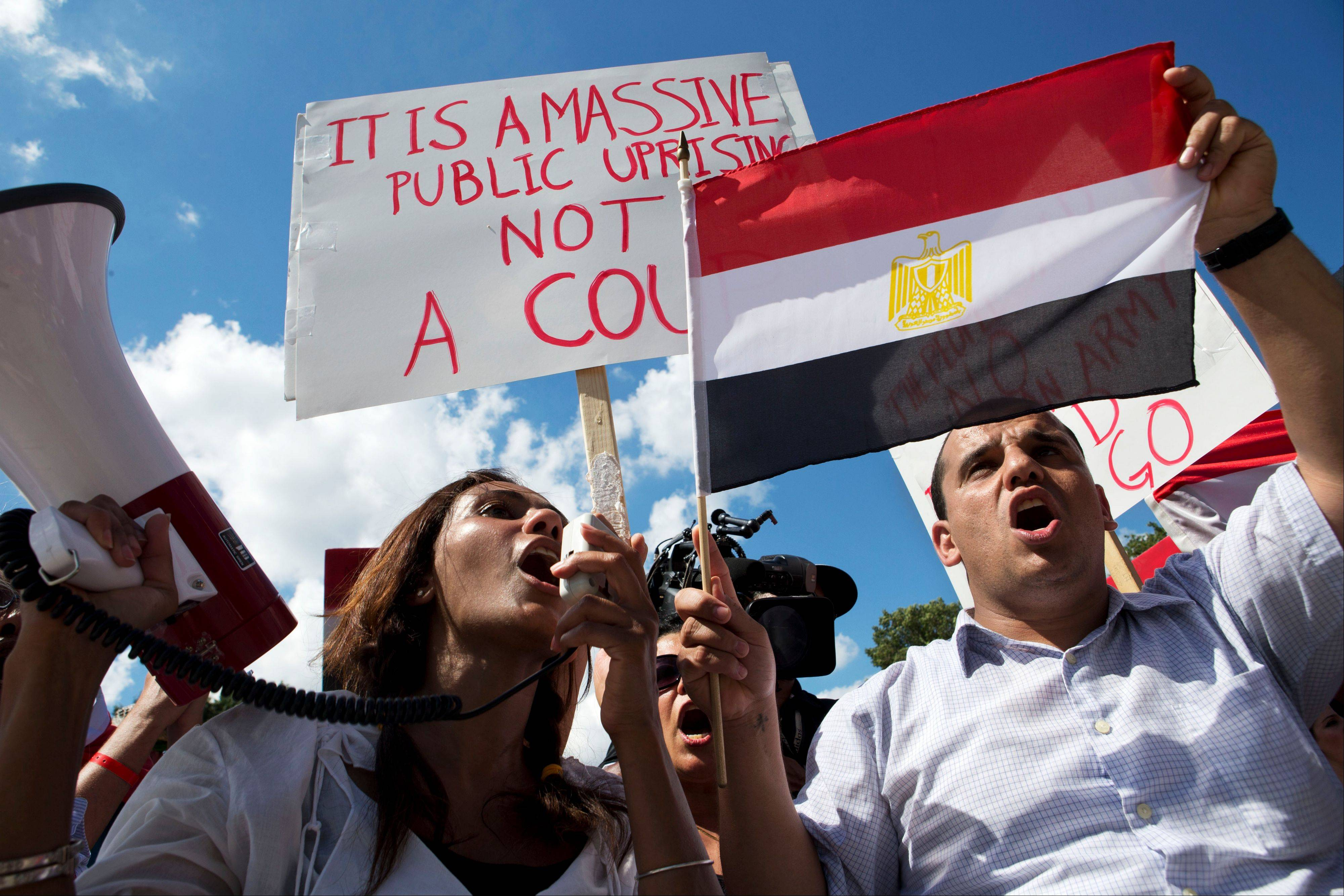 Mena Rashdi, right, of Vienna, Va., rallies with other anti-Morsi demonstrators by the White House in support of the Egyptian military in Washington on Saturday.