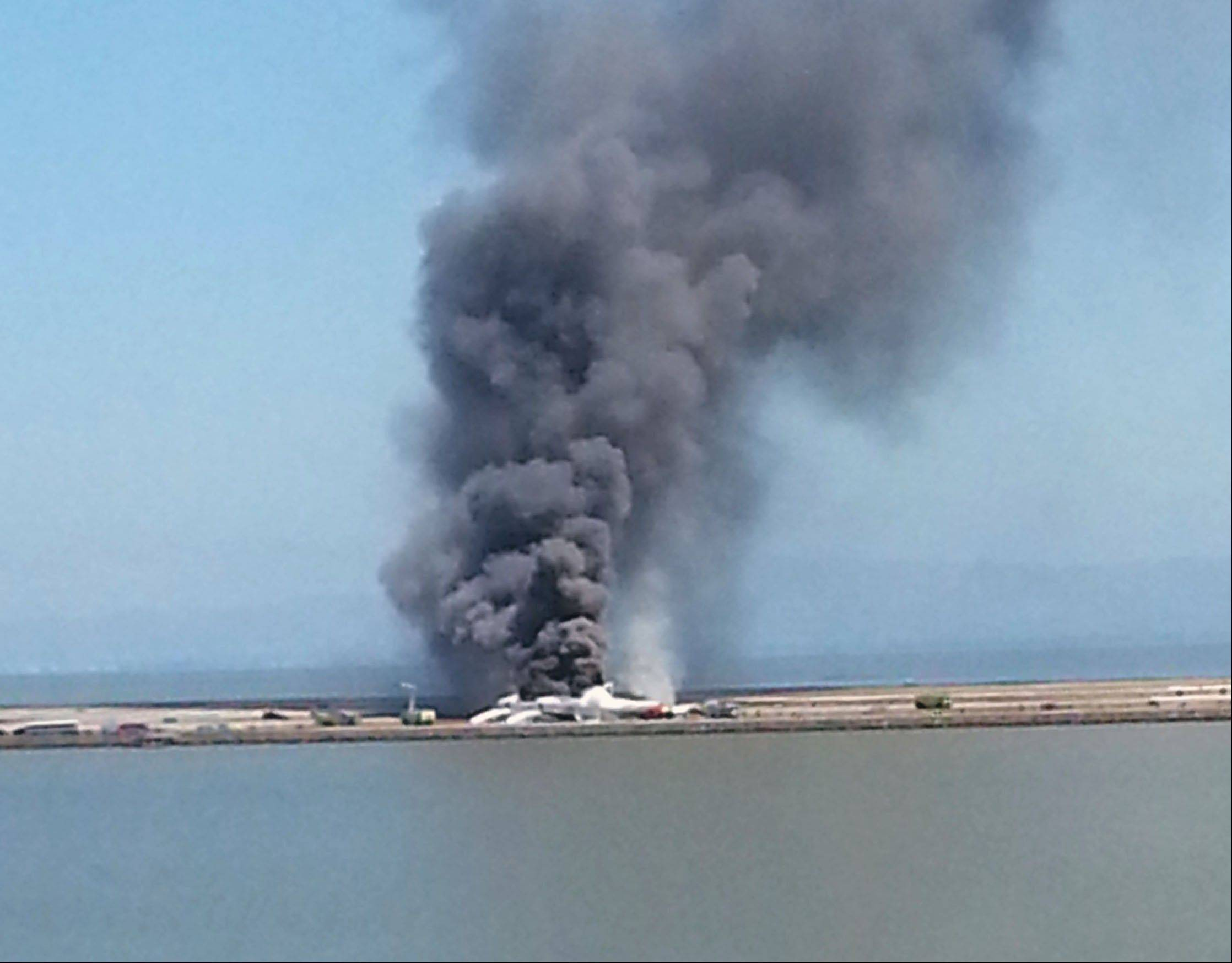 This photo provided by Antonette Edwards shows what a federal aviation official says was an Asiana Airlines flight crashing while landing at San Francisco airport on Saturday, July 6, 2013. It was not immediately known whether there were any injuries.