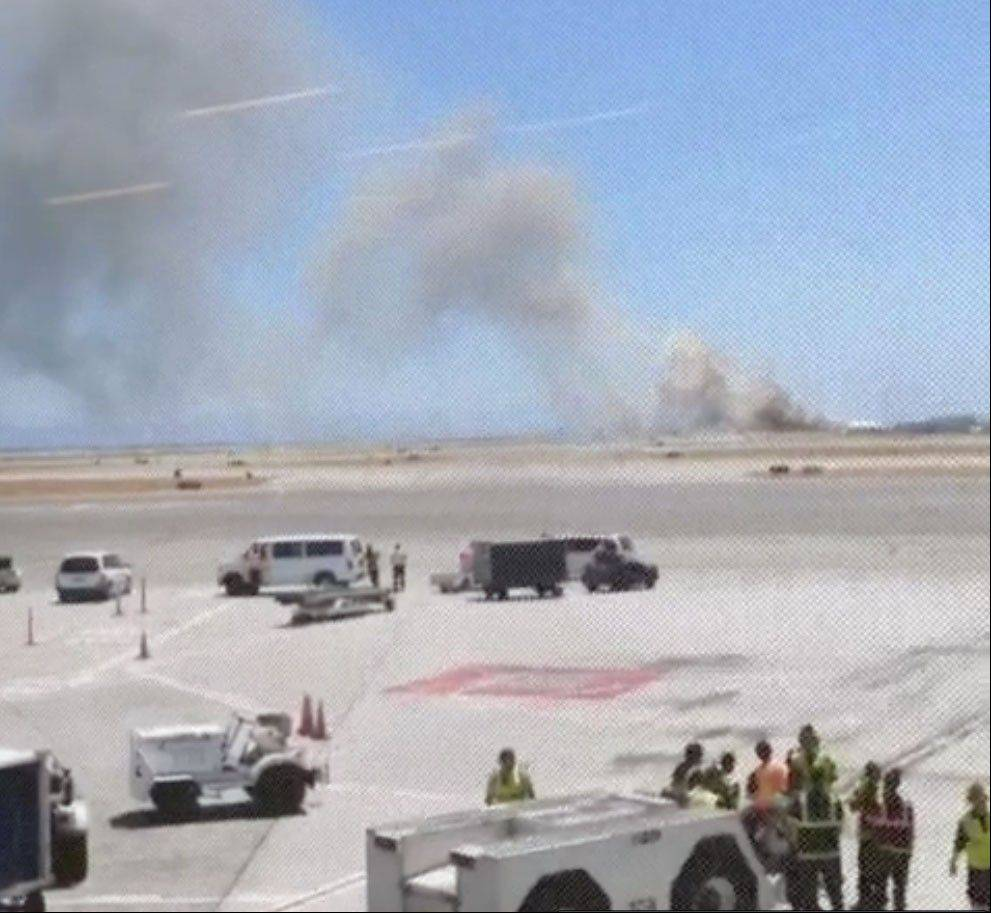 This photo provided by Wei Yeh shows what a federal aviation official says was an Asiana Airlines flight crashing while landing at San Francisco airport on Saturday, July 6, 2013. It was not immediately known whether there were any injuries.