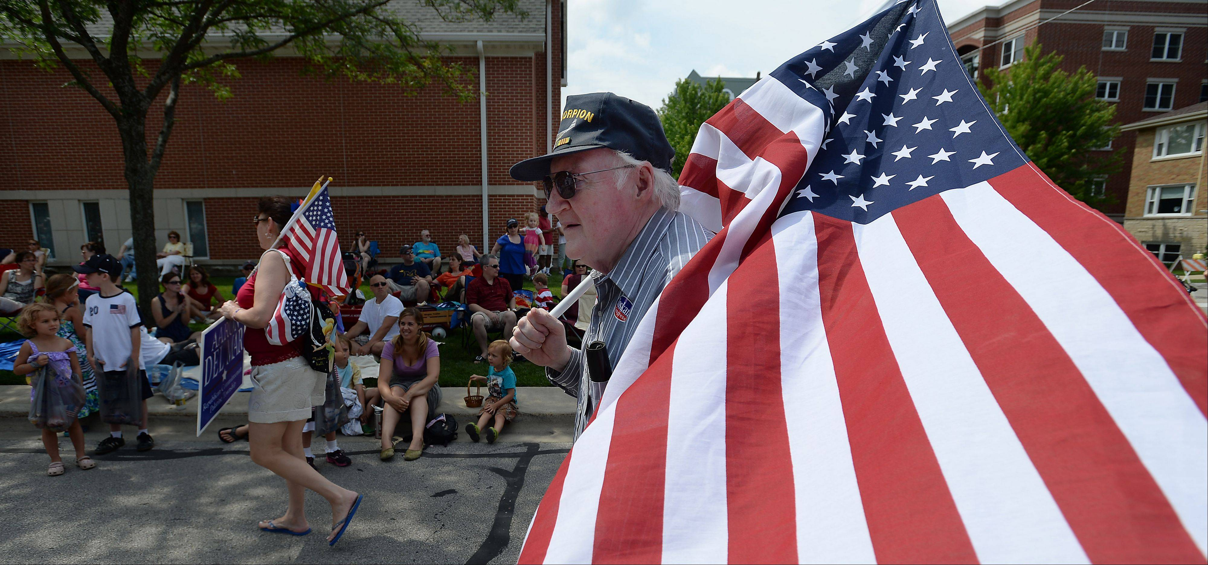 Richard Maxwell of Palatine shows his patriotic spirit during the Palatine Fourth of July parade on Saturday.
