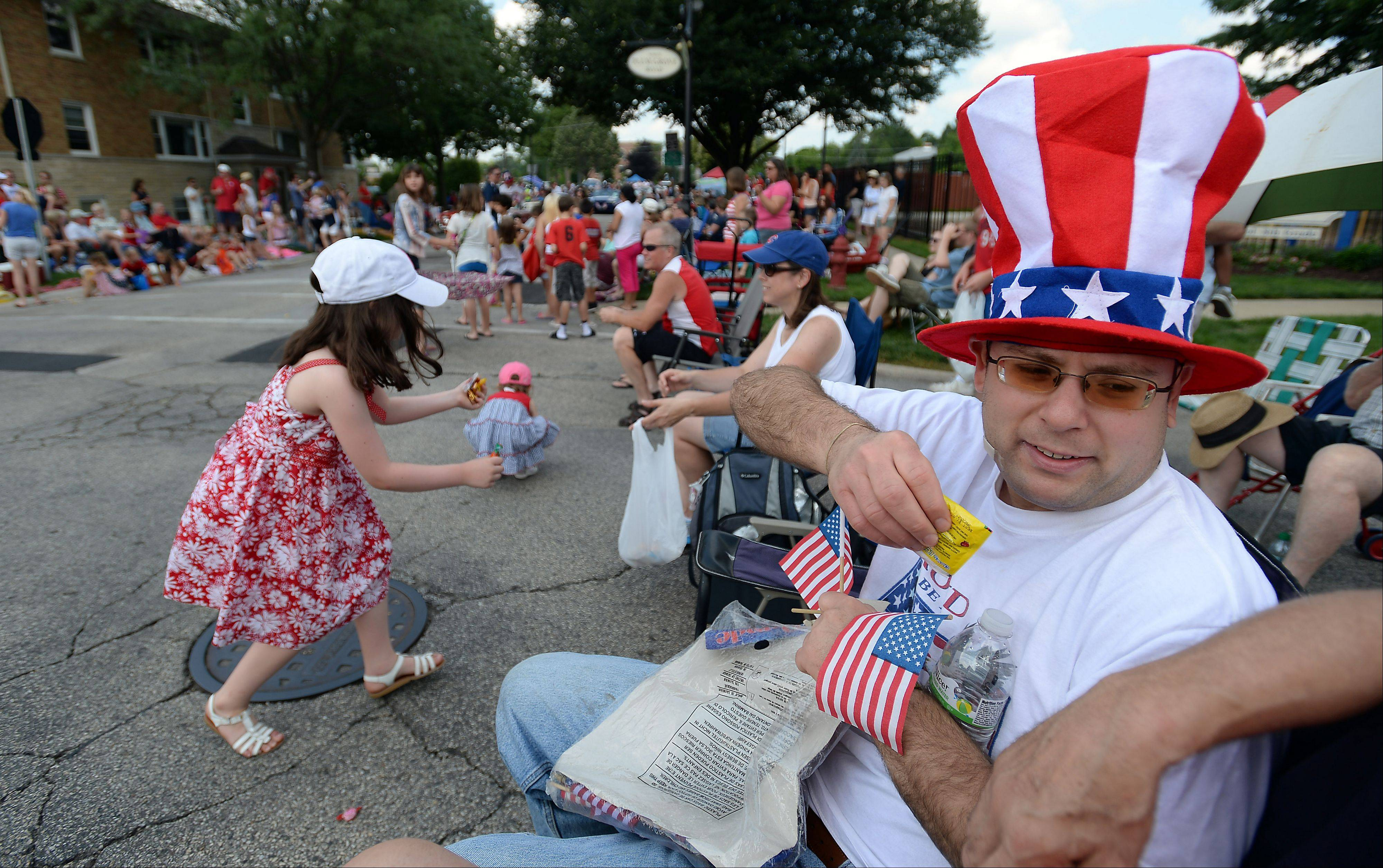 David Wolf of Inverness is happy with his candy supply that he picked up during the Palatine Fourth of July parade on Saturday.