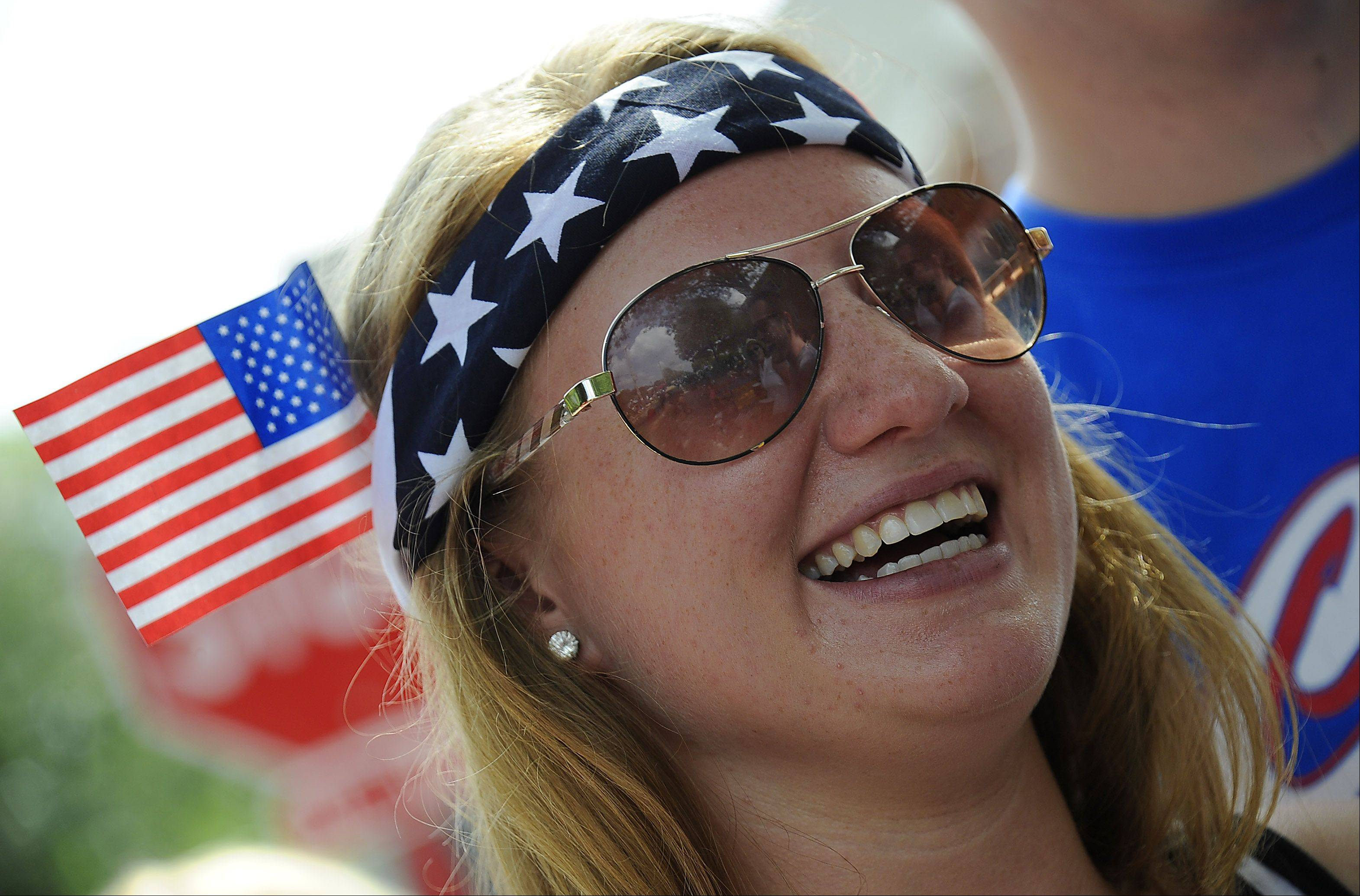 Megan Rogowski, 20, hangs with her friends and enjoys the Palatine Fourth of July parade on Saturday.