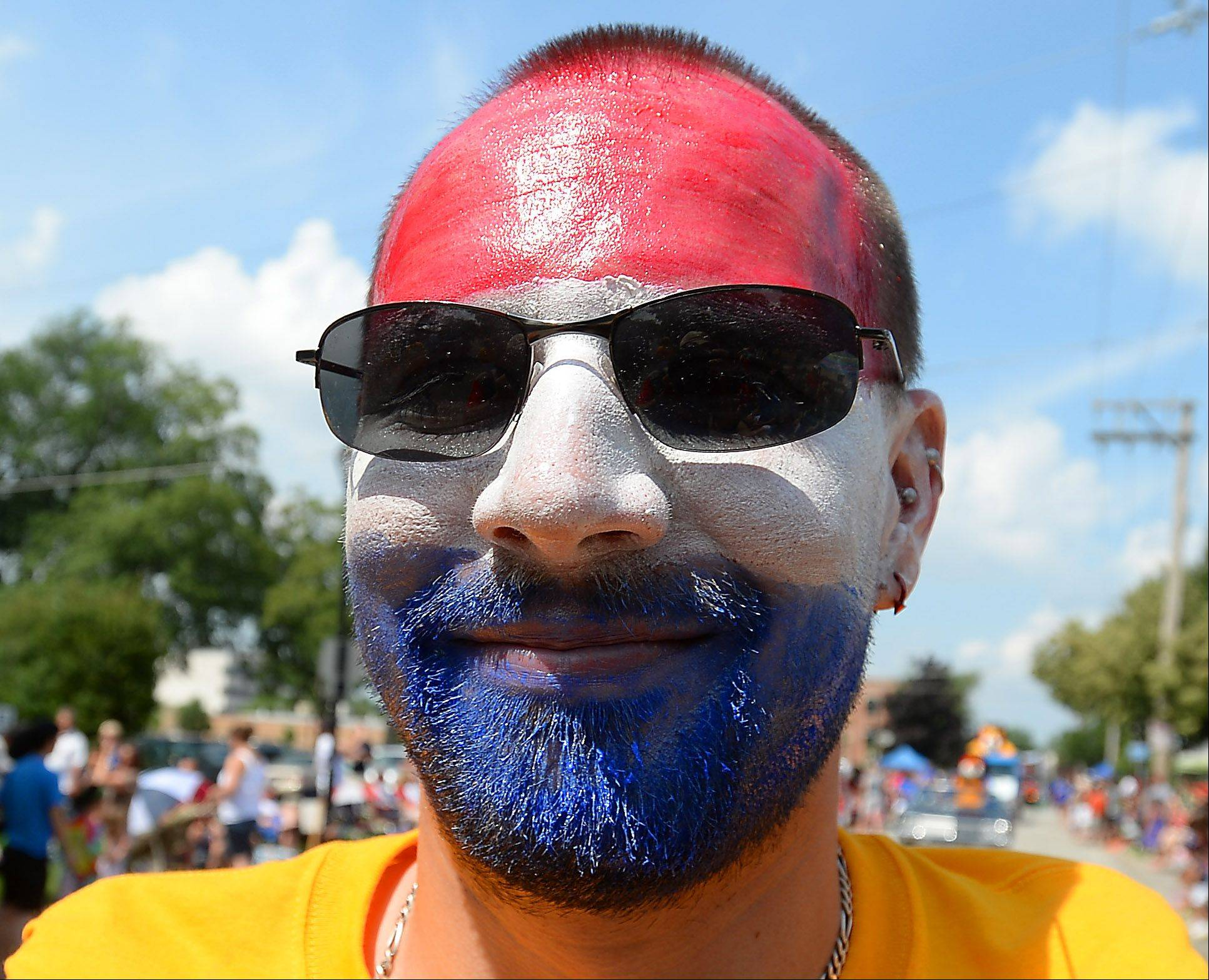 Joe Cole of Palatine sports America's colors during the Palatine Fourth of July parade on Saturday.