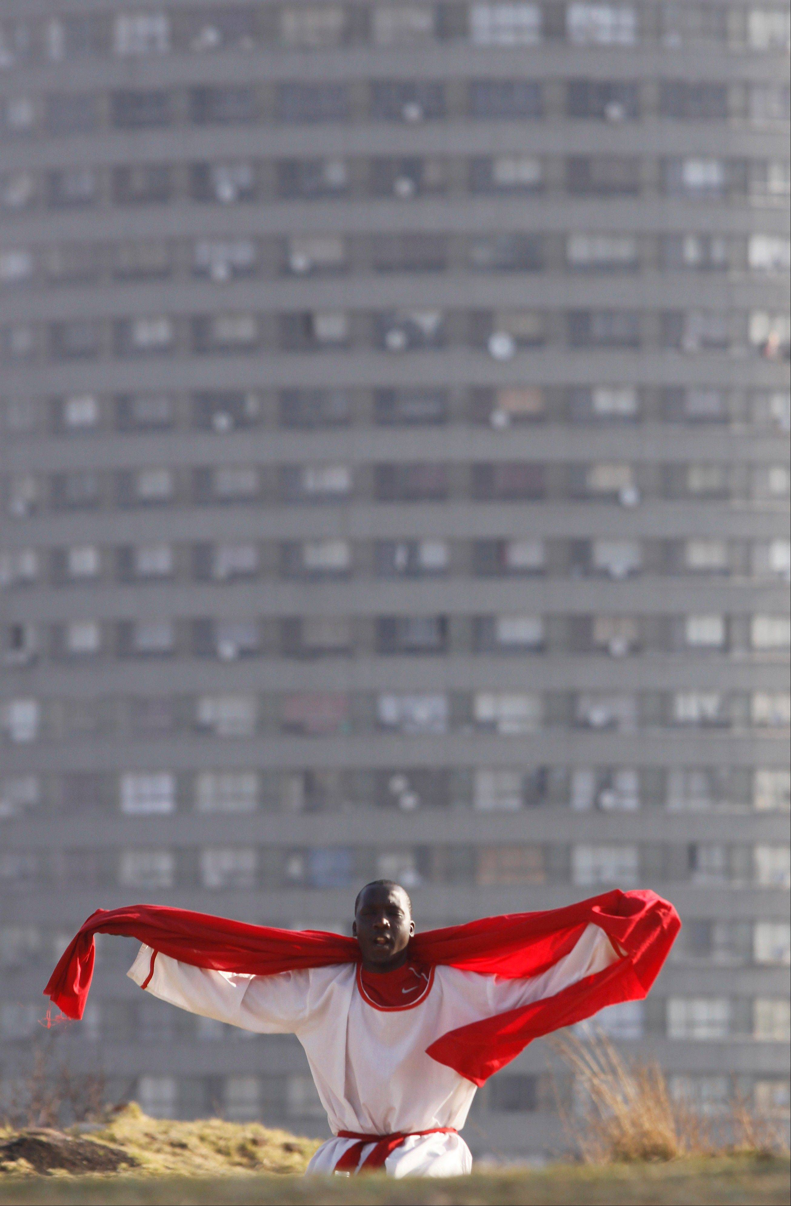 Associated Press/Denis FarrellA worshipper offers prayers on top of a hill overlooking Johannesburg city Saturday July 6. There was no official update Saturday morning on the condition of the 94-year-old former president, Nelson Mandela who is in critical but stable condition after being diagnosed with a recurring lung infection. He was taken to a hospital in Pretoria, the capital, on June 8. There have been calls for prayers to be offered for the former statesman's recovery.