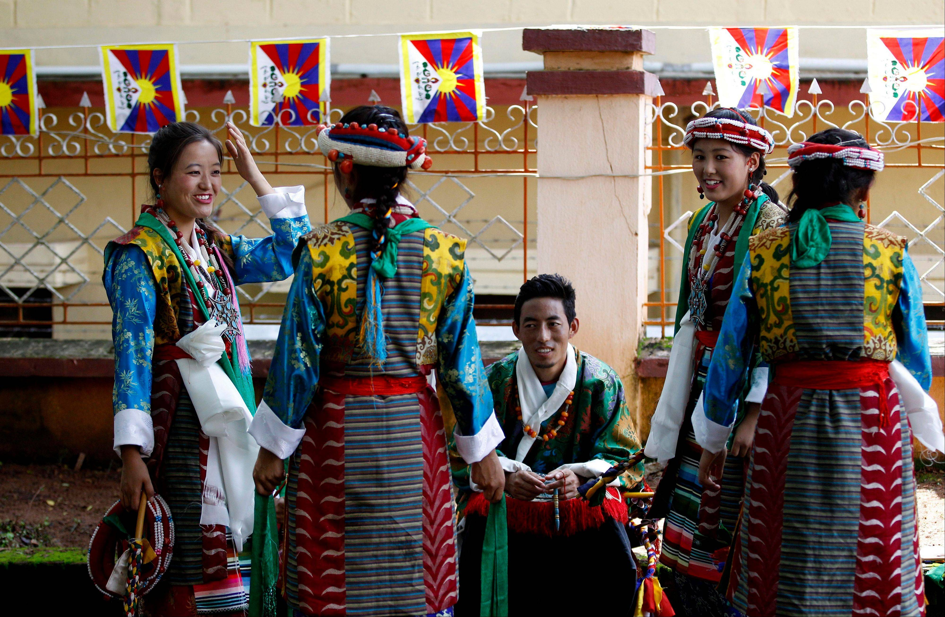 "Traditional Tibetan artists wait backstage for their performance during an event organized to celebrate the 78th birthday of their spiritual leader the Dalai Lama at a Tibetan Buddhist monastery in Bylakuppe, about 137 miles southwest of Bangalore, India, Saturday, July 6. Speaking after an interfaith meeting, he said 150,000 Tibetans living abroad represent ""six million Tibetans (in China) who have no freedom or opportunity to express what they feel."""