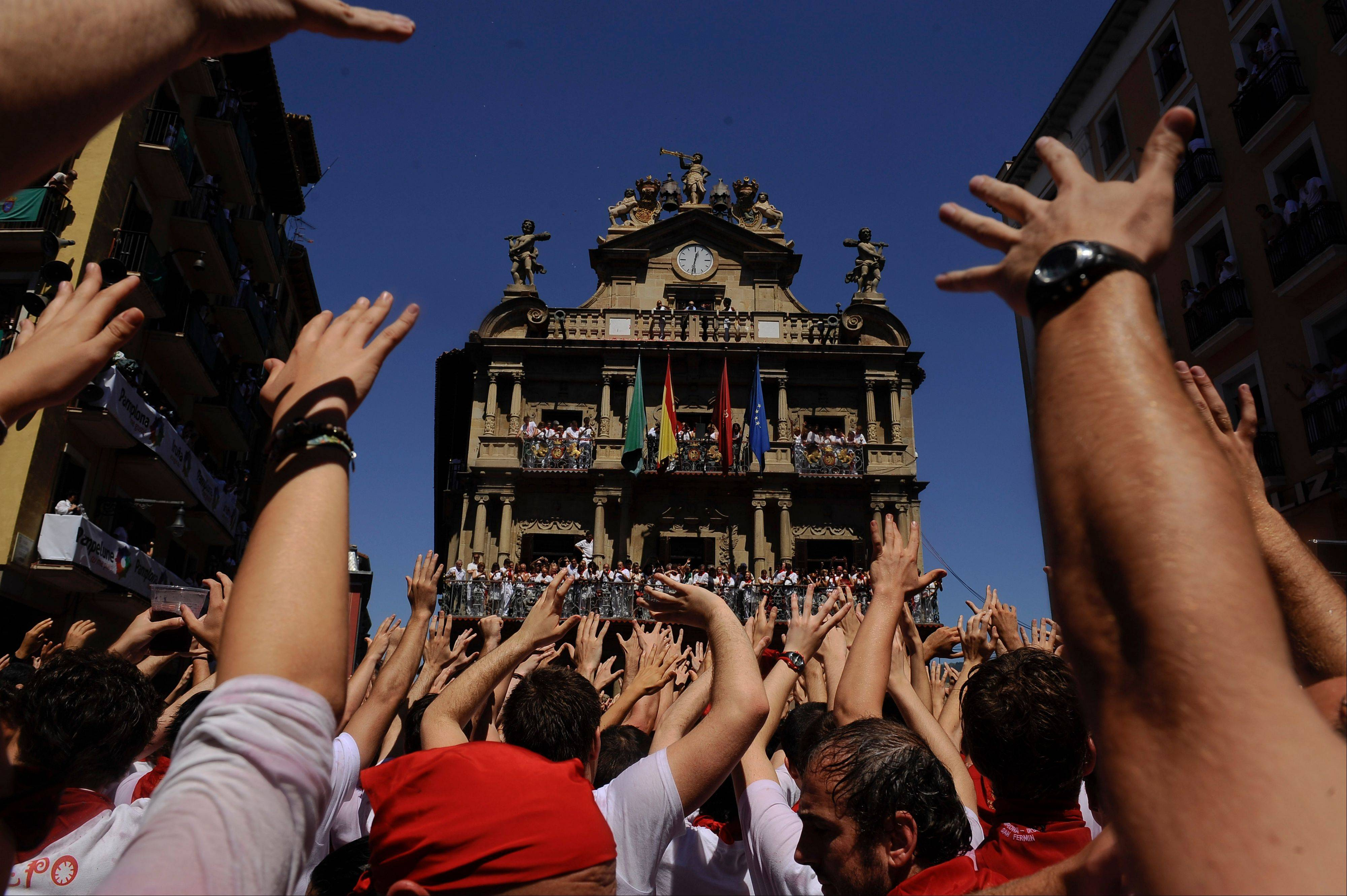 "Revelers enjoy themselves in Ayuntamiento square, in Pamplona, northern Spain on Saturday, July 6, celebrating the start of Spain's most famous bull-running festival with the annual launch of the ""chupinazo"" rocket. Perhaps best glorified by Ernest Hemingway's 1926 novel ""The Sun Also Rises,"" the San Fermin festival is known around the world for the daily running of the bulls."