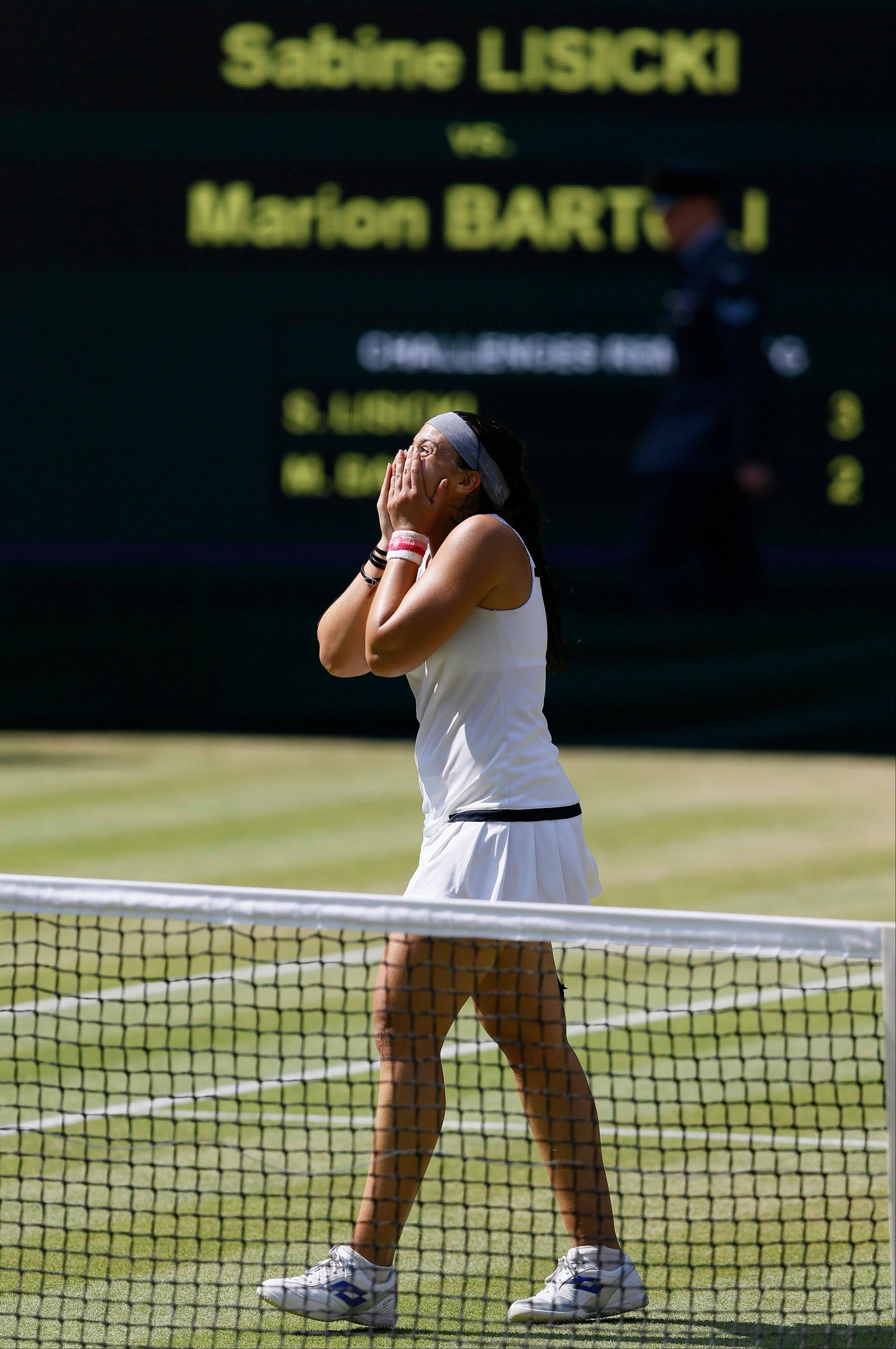 Marion Bartoli of France reacts as she wins the Women's singles final match against Sabine Lisicki of Germany at the All England Lawn Tennis Championships in Wimbledon, London, Saturday, July 6.