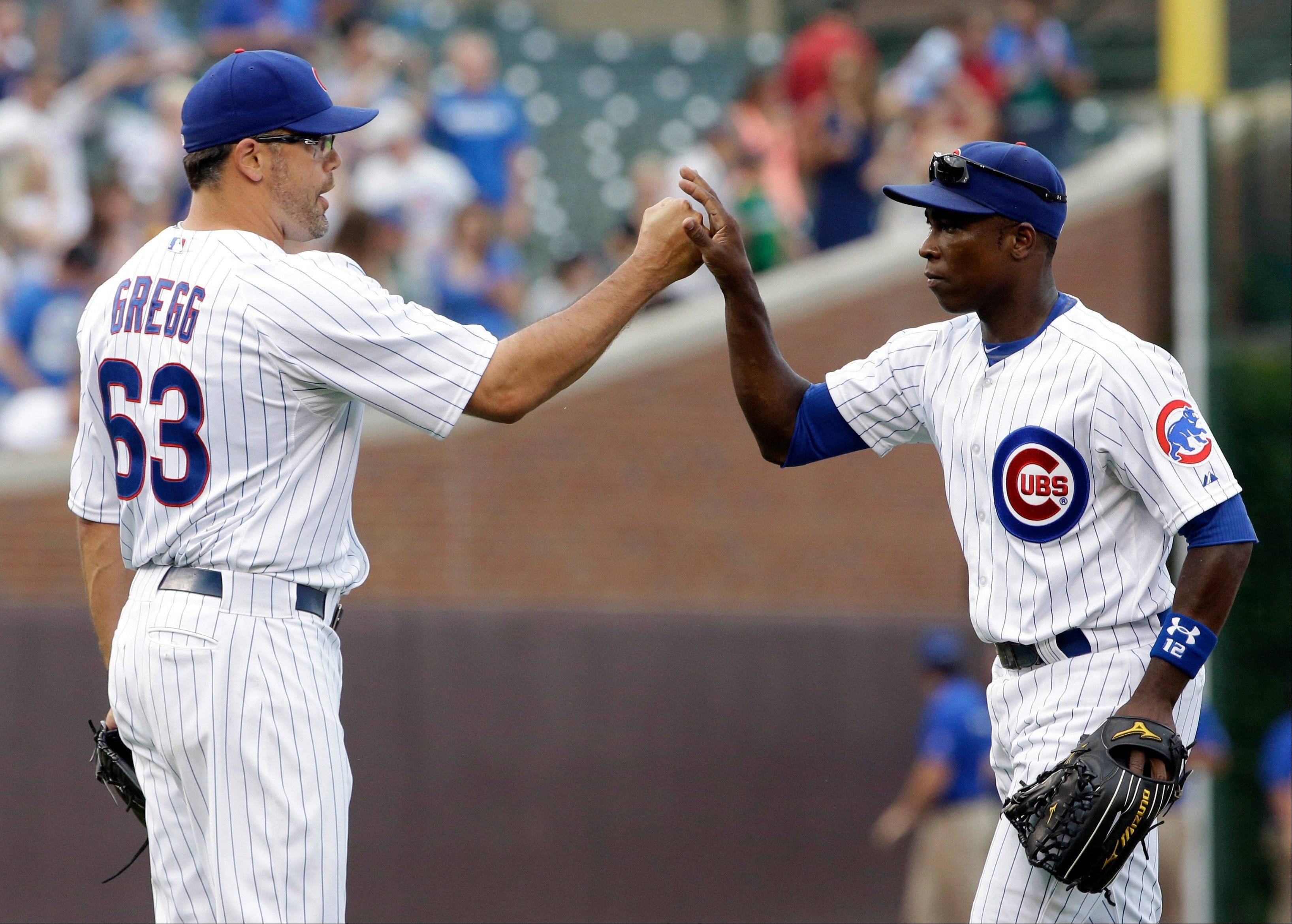 Cubs outfielder Alfonso Soriano, right, celebrates with closer Kevin Gregg after the Cubs defeated the Pittsburgh Pirates 4-1 Saturday at Wrigley Field.