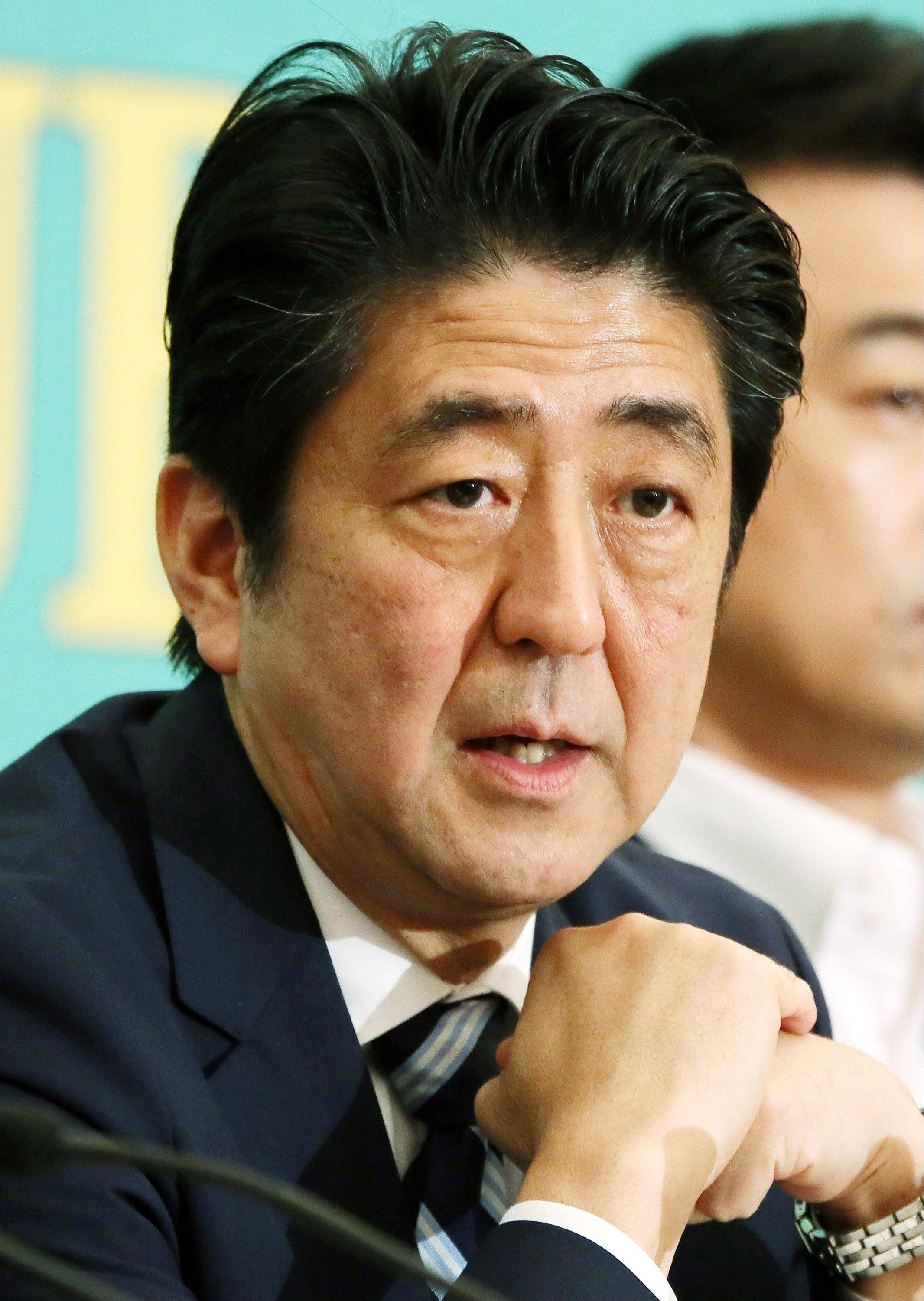 Shinzo Abe, Japan's prime minister and president of the Liberal Democratic Party (LDP), speaks during a debate at the Japan National Press Club in Tokyo, Japan, on Wednesday, July 3, 2013.