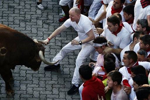 Several thousand thrill-seekers tested their bravery by dashing alongside six fighting bulls through the streets of the northern Spanish city of Pamplona on the first day of the running of the bulls at the annual San Fermin festival on Sunday.