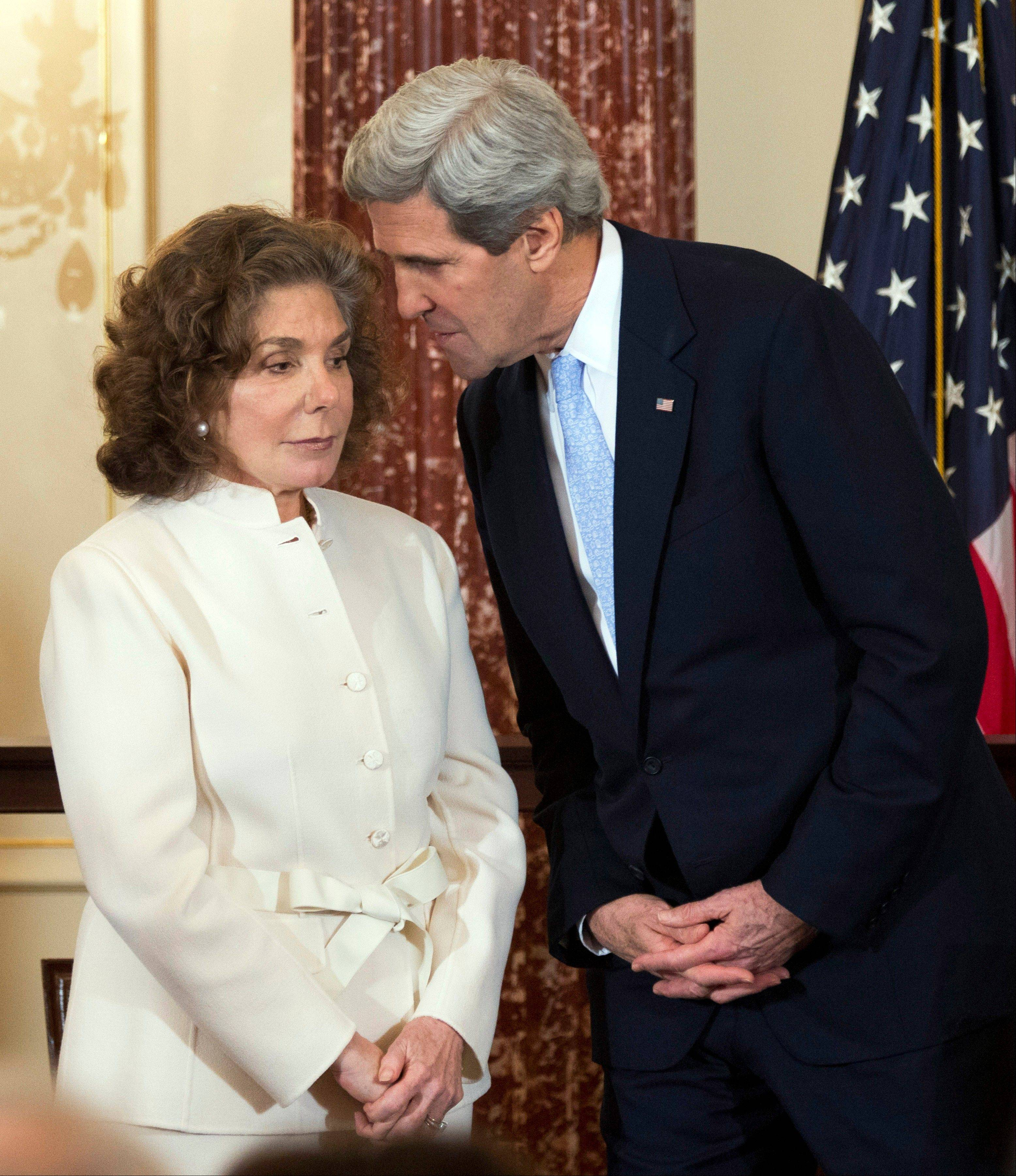 Secretary of State John Kerry, right, whispers to his wife, Teresa Heinz Kerry, during the ceremonial swearing-in for him as the 68th secretary of state at the State Department in Washington. A hospital spokesman says Teresa Heinz Kerry, the wife of U.S. Secretary of State John Kerry, is hospitalized Sunday in critical but stable condition.