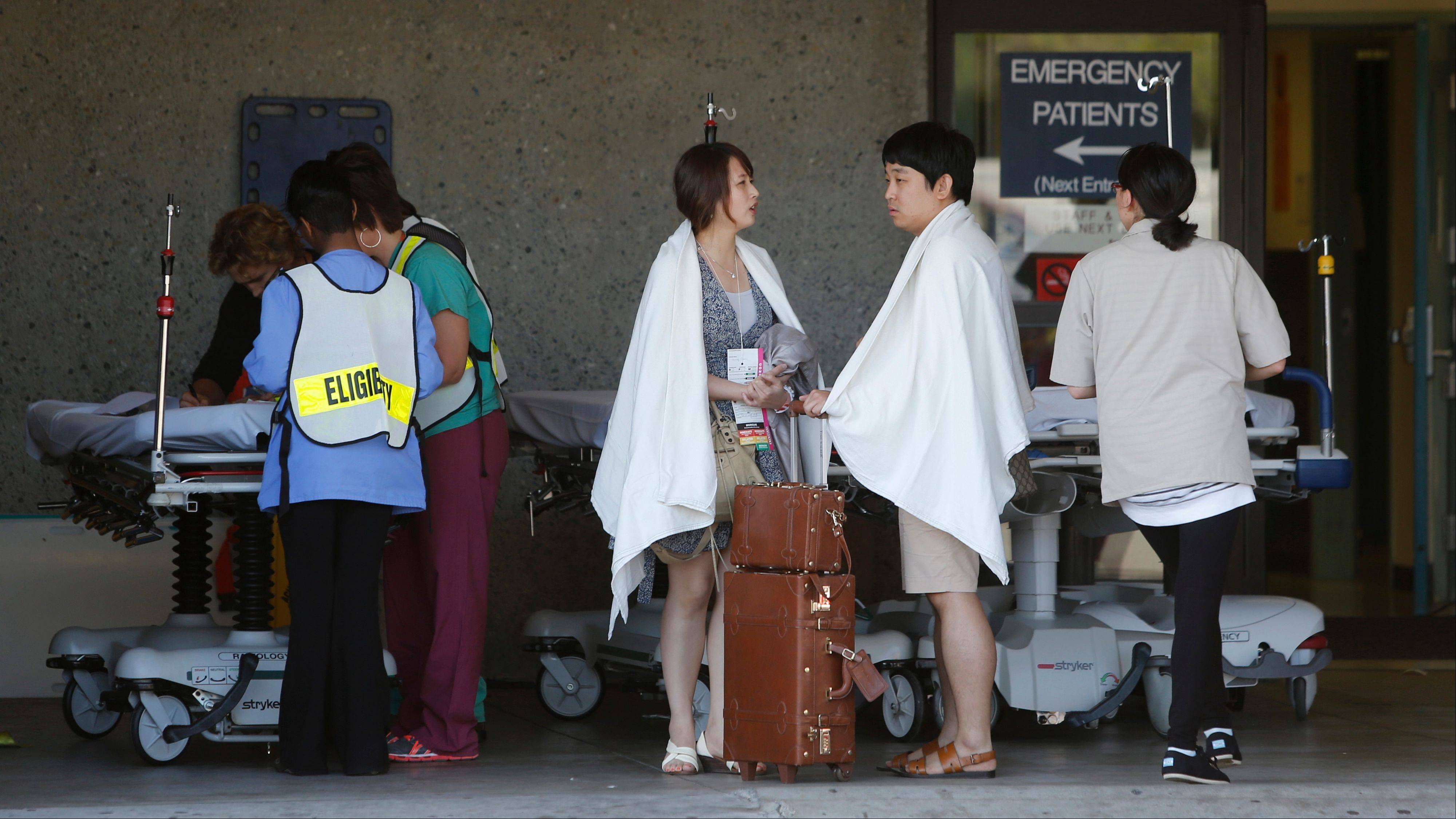 Passengers from Asiana Flight 214 are treated at San Francisco General Hospital after the plane crashed at San Francisco International Airport in San Francisco, Saturday.