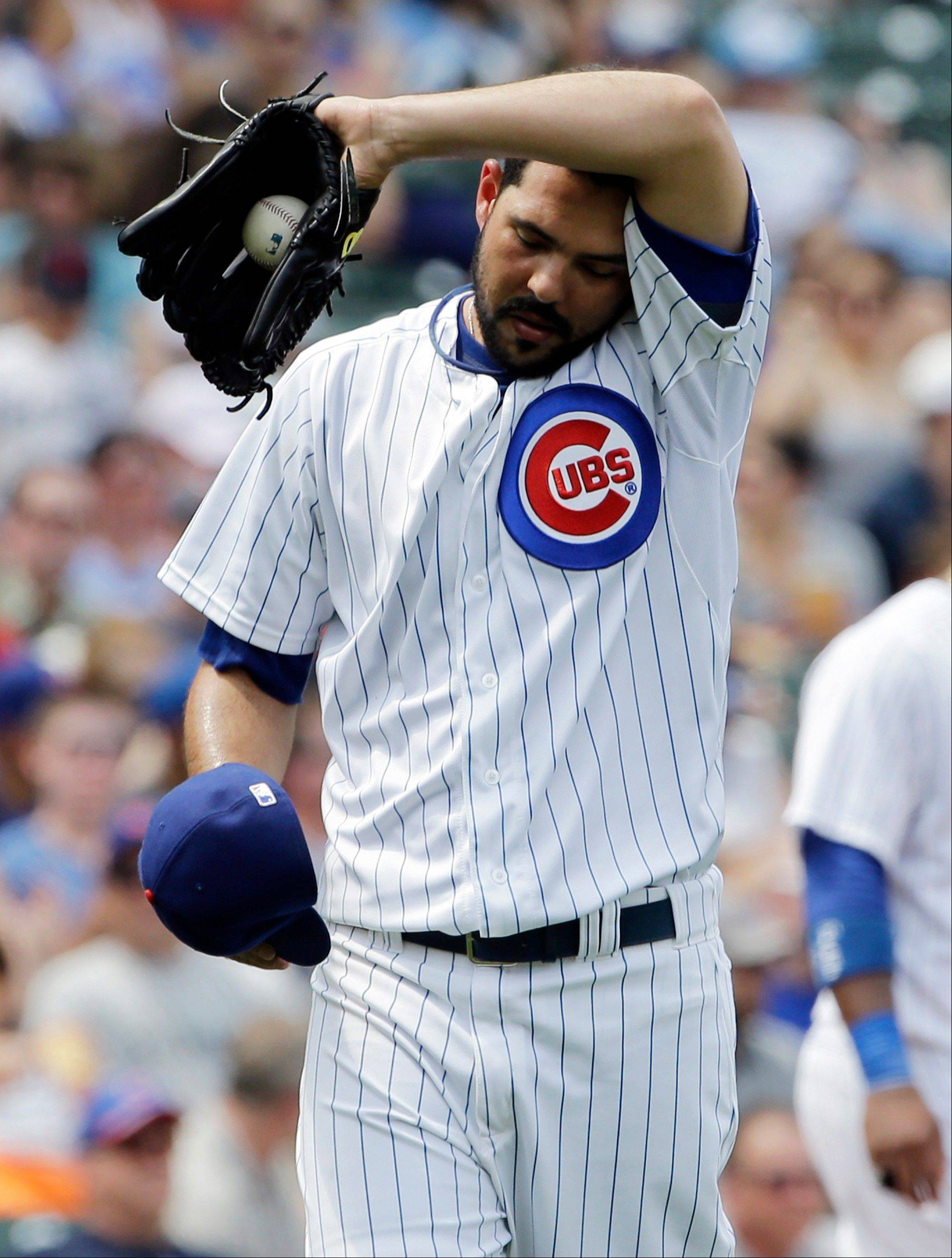 Cubs starter Carlos Villanueva reacts after the Pirates' Andrew McCutchen hit an RBI double during the fourth inning Sunday.