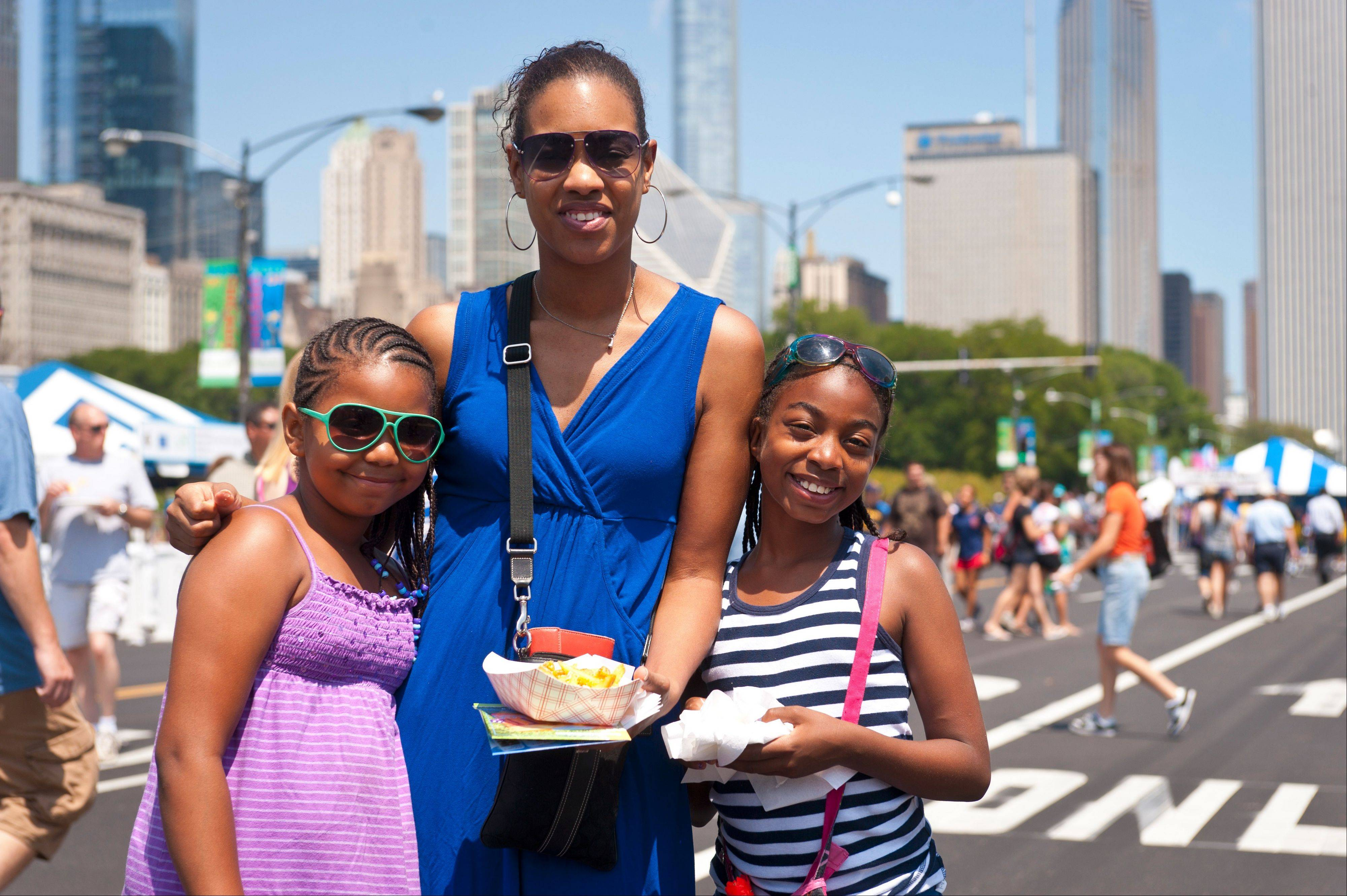 A family enjoys their food at the Taste of Chicago.