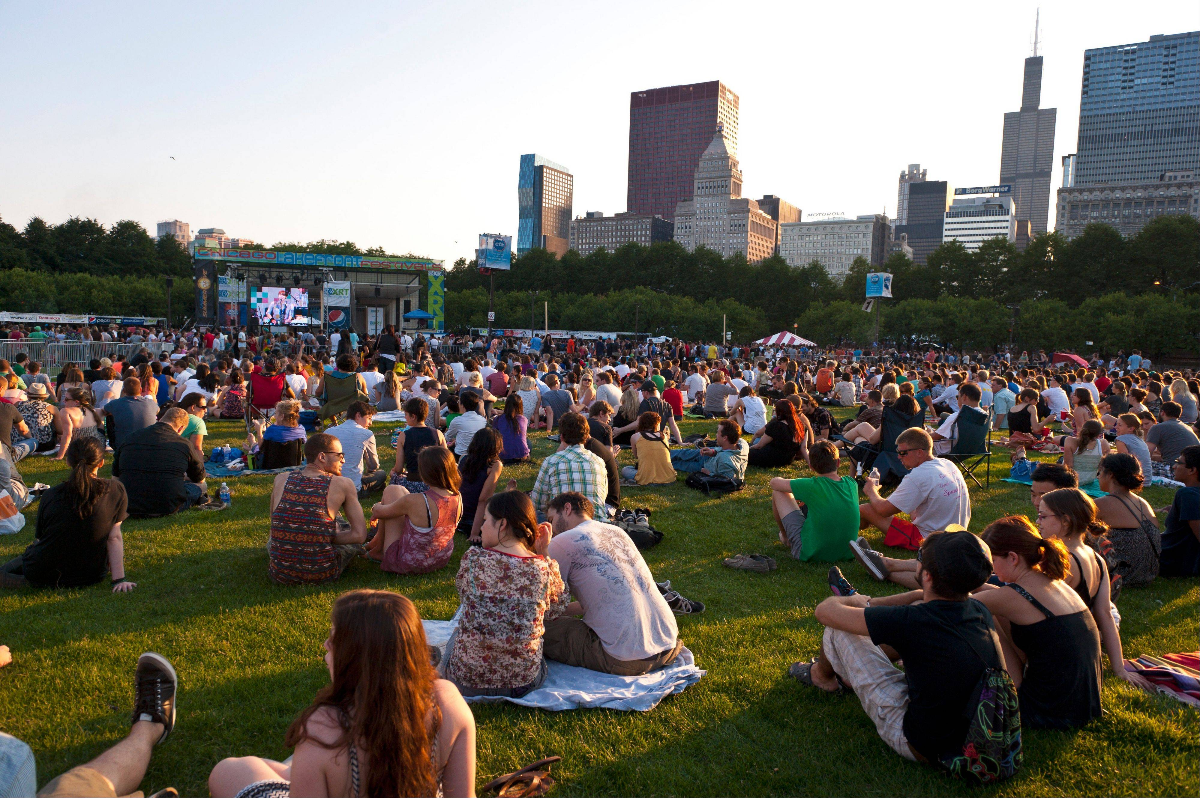Free lawn seating provides a chance to enjoy concerts during the Taste of Chicago held in Grant Park.