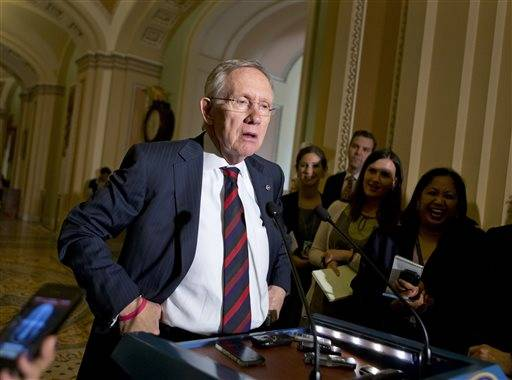 Senate Majority Leader Harry Reid, D-Nev., updates reporters on the pace of the immigration reform bill after a Democratic strategy session at the Capitol in Washington. Congress returns this week to potentially incendiary fights over nominations, disputes over student loans and the farm bill.