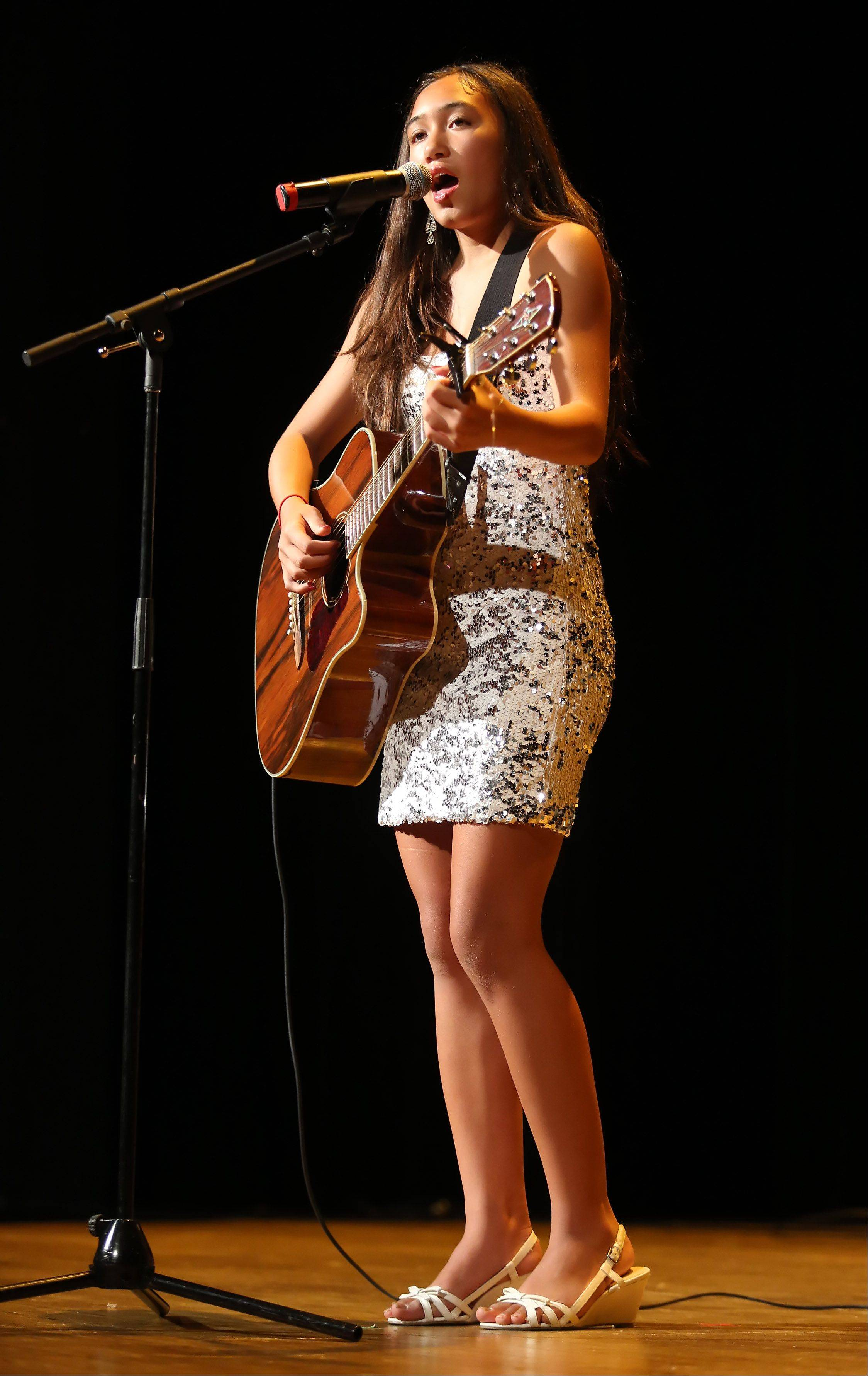 Alexis Mai Nguyen of Pingree Grove plays the guitar Sunday during the second round of performances by finalists of the Suburban Chicago's Got Talent competition at the Metropolis Performing Arts Centre in Arlington Heights. The summer long talent contest is presented by the Daily Herald and sponsored by the Arlington Heights Chamber of Commerce.