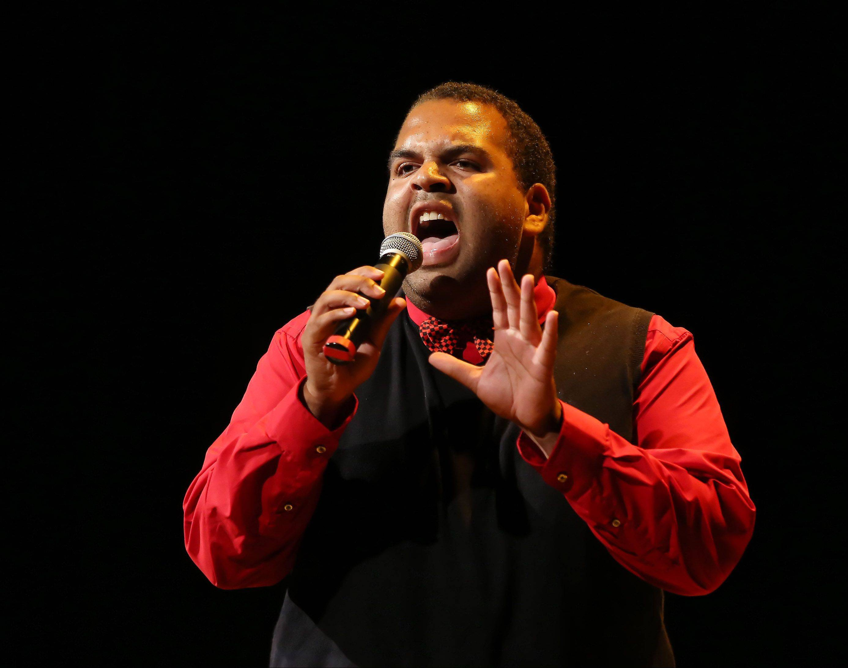 Andrew Johnston of Bourbonnais sings Sunday during the second round of performances by finalists of the Suburban Chicago's Got Talent competition at the Metropolis Performing Arts Centre in Arlington Heights. The summer long talent contest is presented by the Daily Herald and sponsored by the Arlington Heights Chamber of Commerce.