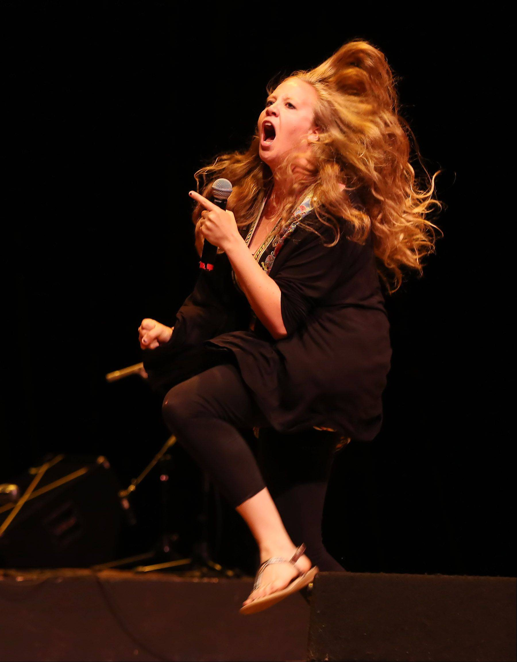 Comedian Tiffany Streng of Arlington Heights performs Sunday during the second round of performances by finalists of the Suburban Chicago's Got Talent competition at the Metropolis Performing Arts Centre in Arlington Heights. The summer long talent contest is presented by the Daily Herald and sponsored by the Arlington Heights Chamber of Commerce.