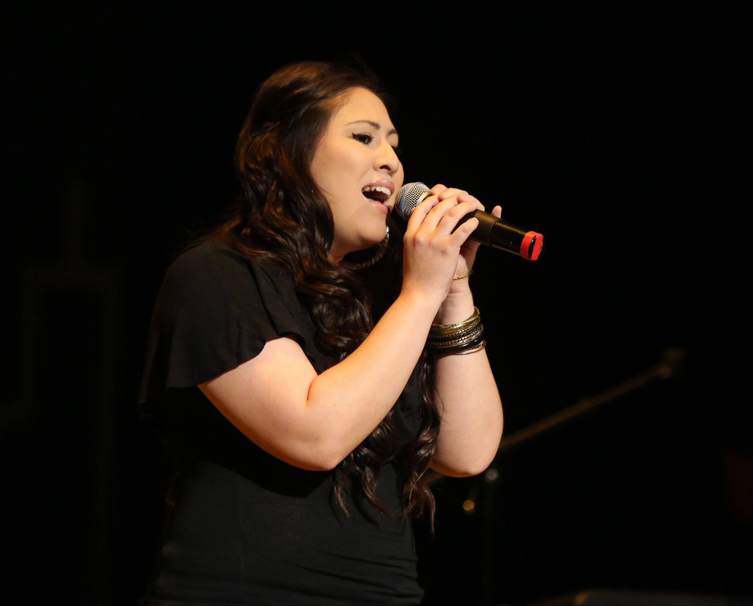 Alex Guzman of West Chicago sings Sunday during the second round of performances by finalists of the Suburban Chicago's Got Talent competition at the Metropolis Performing Arts Centre in Arlington Heights. The summer long talent contest is presented by the Daily Herald and sponsored by the Arlington Heights Chamber of Commerce.