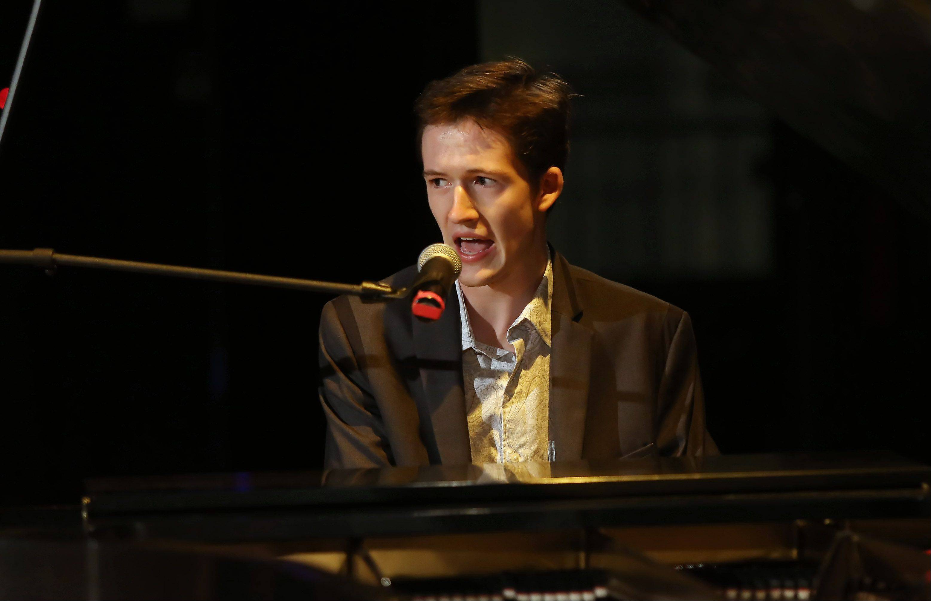 Riley Mangan of Arlington Heights plays jazz piano Sunday during the second round of performances by finalists of the Suburban Chicago's Got Talent competition at the Metropolis Performing Arts Centre in Arlington Heights. The summer long talent contest is presented by the Daily Herald and sponsored by the Arlington Heights Chamber of Commerce.