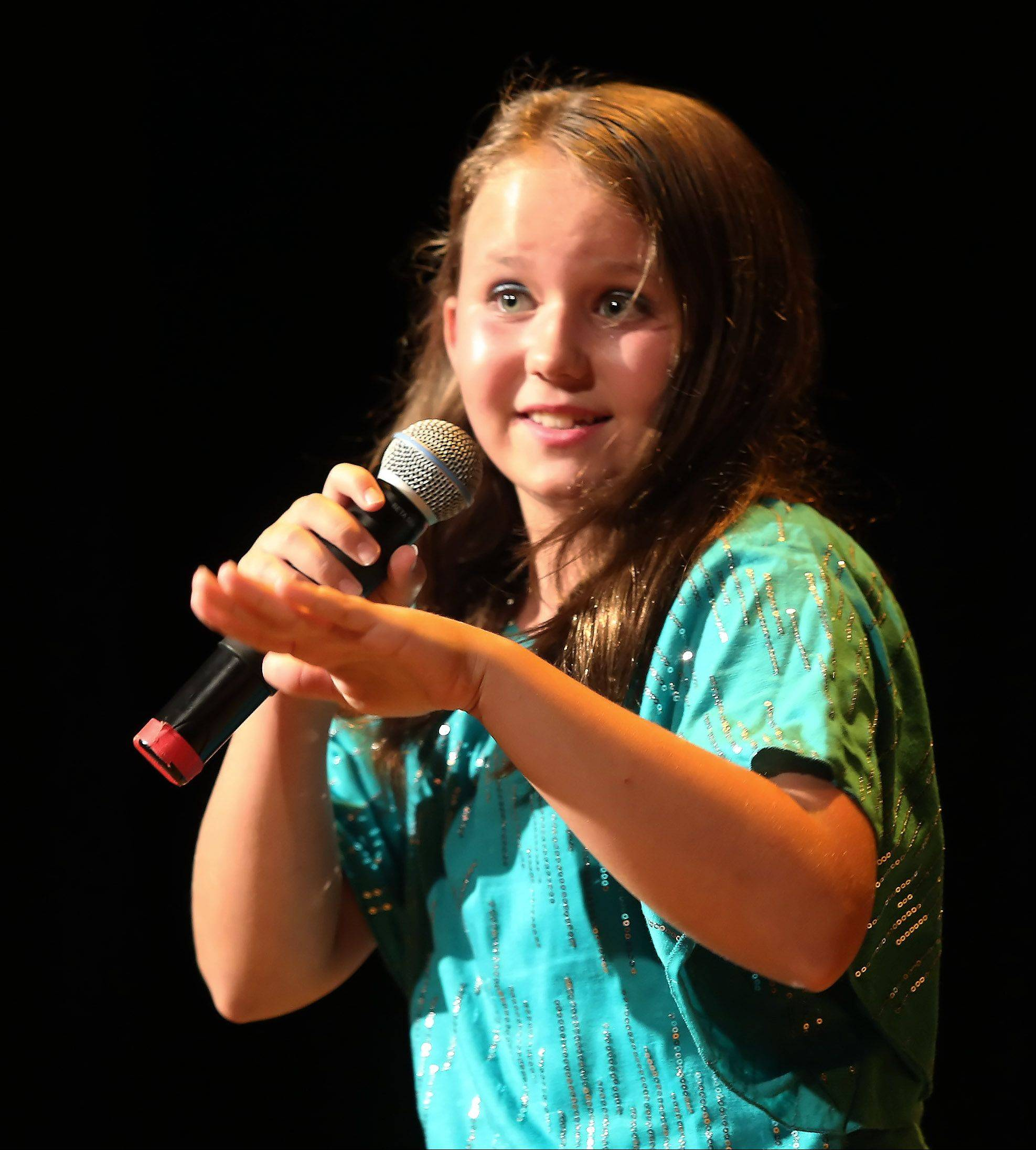Mary Hilbrink, 10, of Fox River Grove sings Sunday during the second round of performances by finalists of the Suburban Chicago's Got Talent competition at the Metropolis Performing Arts Centre in Arlington Heights. The summer long talent contest is presented by the Daily Herald and sponsored by the Arlington Heights Chamber of Commerce.