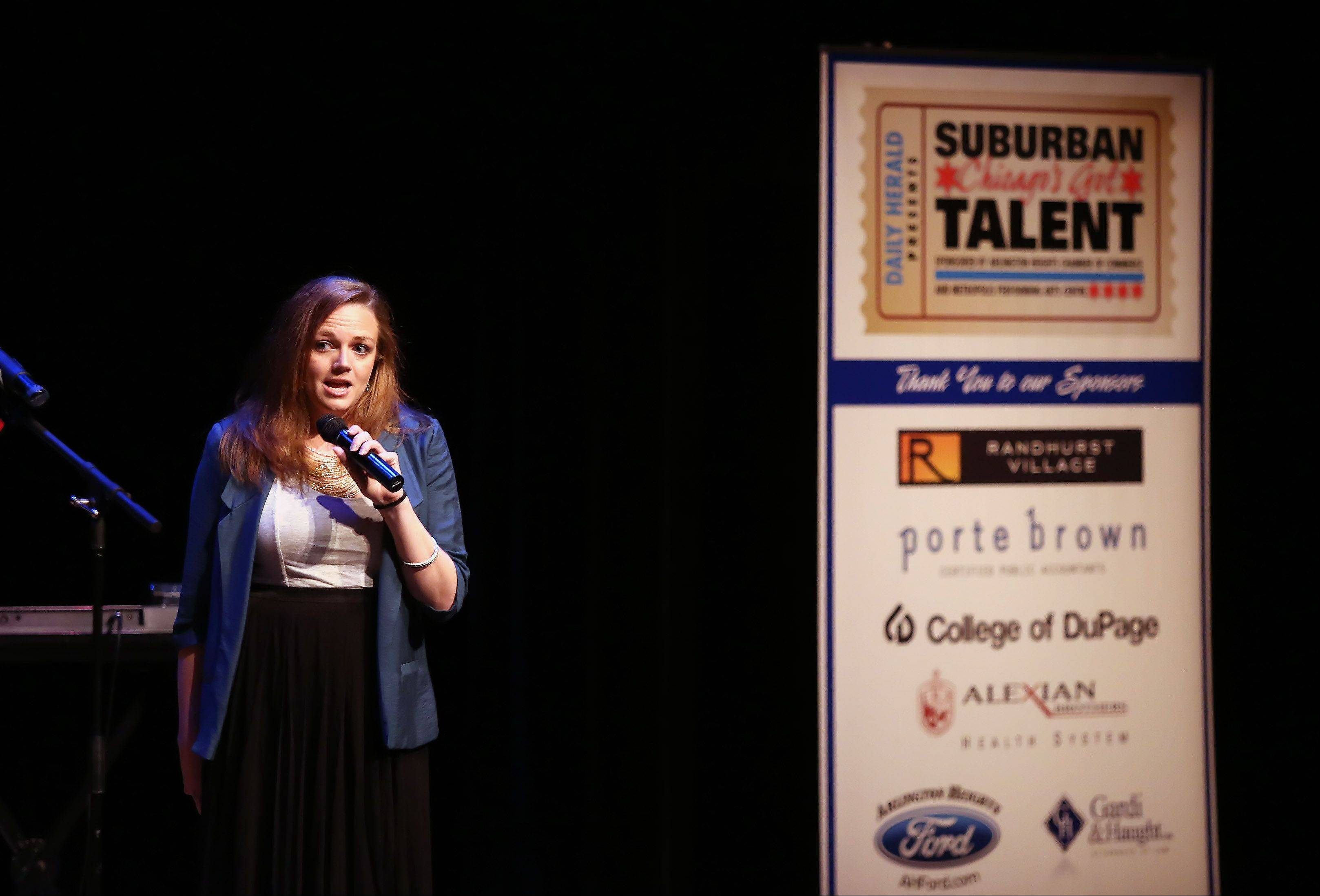 MC Michelle Shaver talks to the judges Sunday during the second round of performances by finalists of the Suburban Chicago's Got Talent competition at the Metropolis Performing Arts Centre in Arlington Heights. The summer long talent contest is presented by the Daily Herald and sponsored by the Arlington Heights Chamber of Commerce.