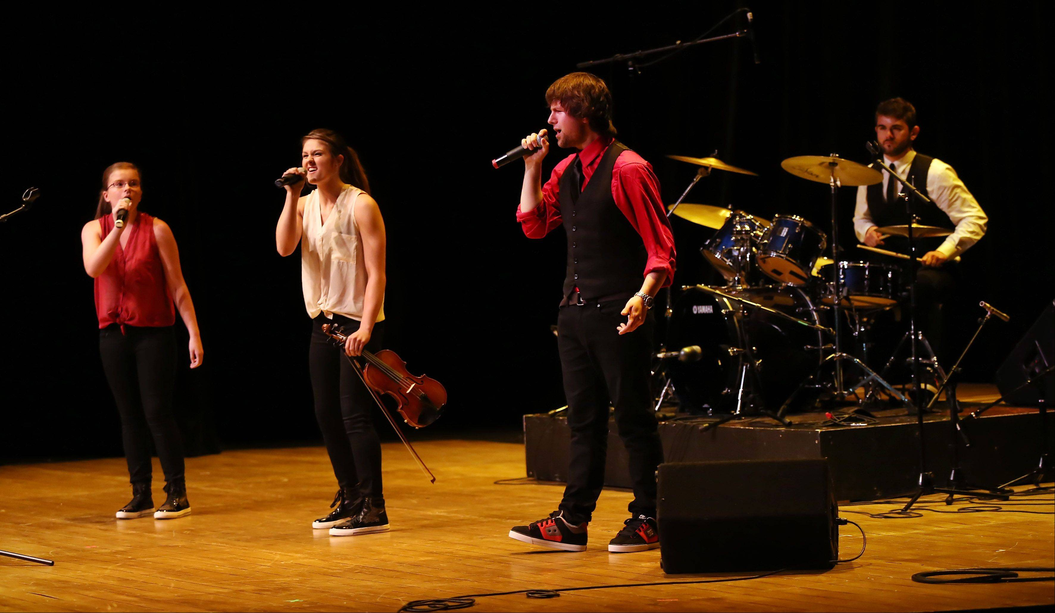 The family band No Immunity of Arlington Heights performs Sunday during the second round of performances by finalists of the Suburban Chicago's Got Talent competition at the Metropolis Performing Arts Centre in Arlington Heights. The summer long talent contest is presented by the Daily Herald and sponsored by the Arlington Heights Chamber of Commerce.