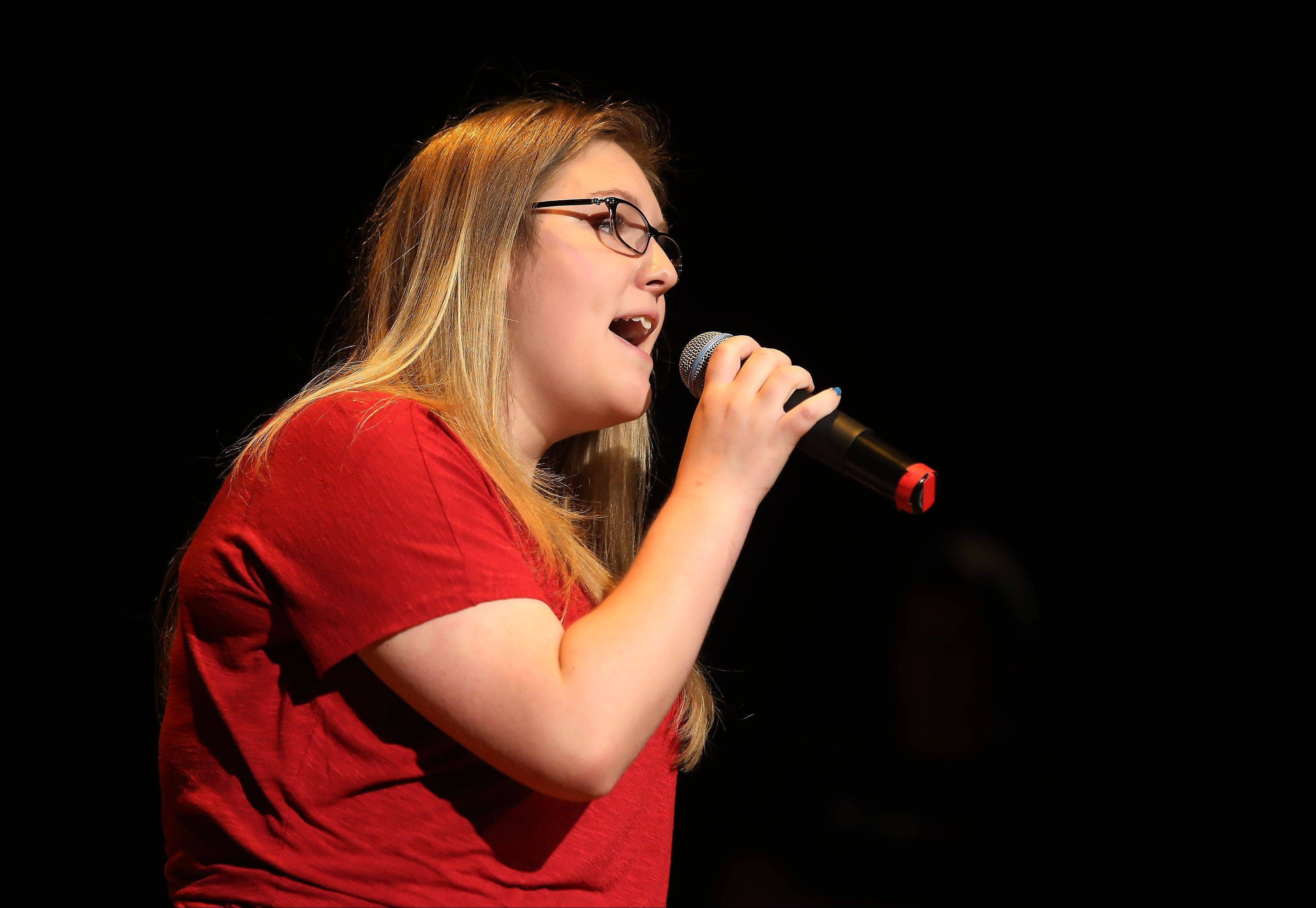Sarah Norman of Carol Stream sings Sunday during the second round of performances by finalists of the Suburban Chicago's Got Talent competition at the Metropolis Performing Arts Centre in Arlington Heights. The summer long talent contest is presented by the Daily Herald and sponsored by the Arlington Heights Chamber of Commerce.