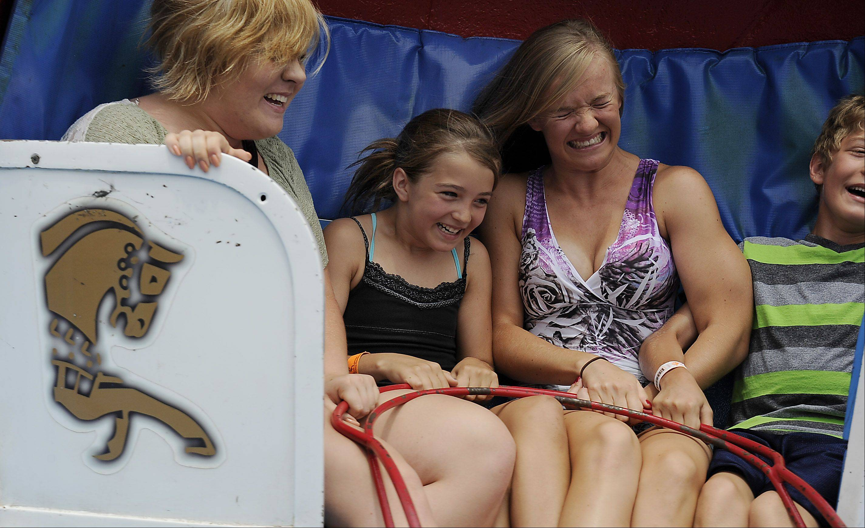 The Tilt A Whirl gives the Golaszewski kids, Elizabeth, 21, Olivia, 12, Jessica, 17, and Peter, 12, all of Bartlett, a fun afternoon at the Bartlett fourth of July festival on Saturday.