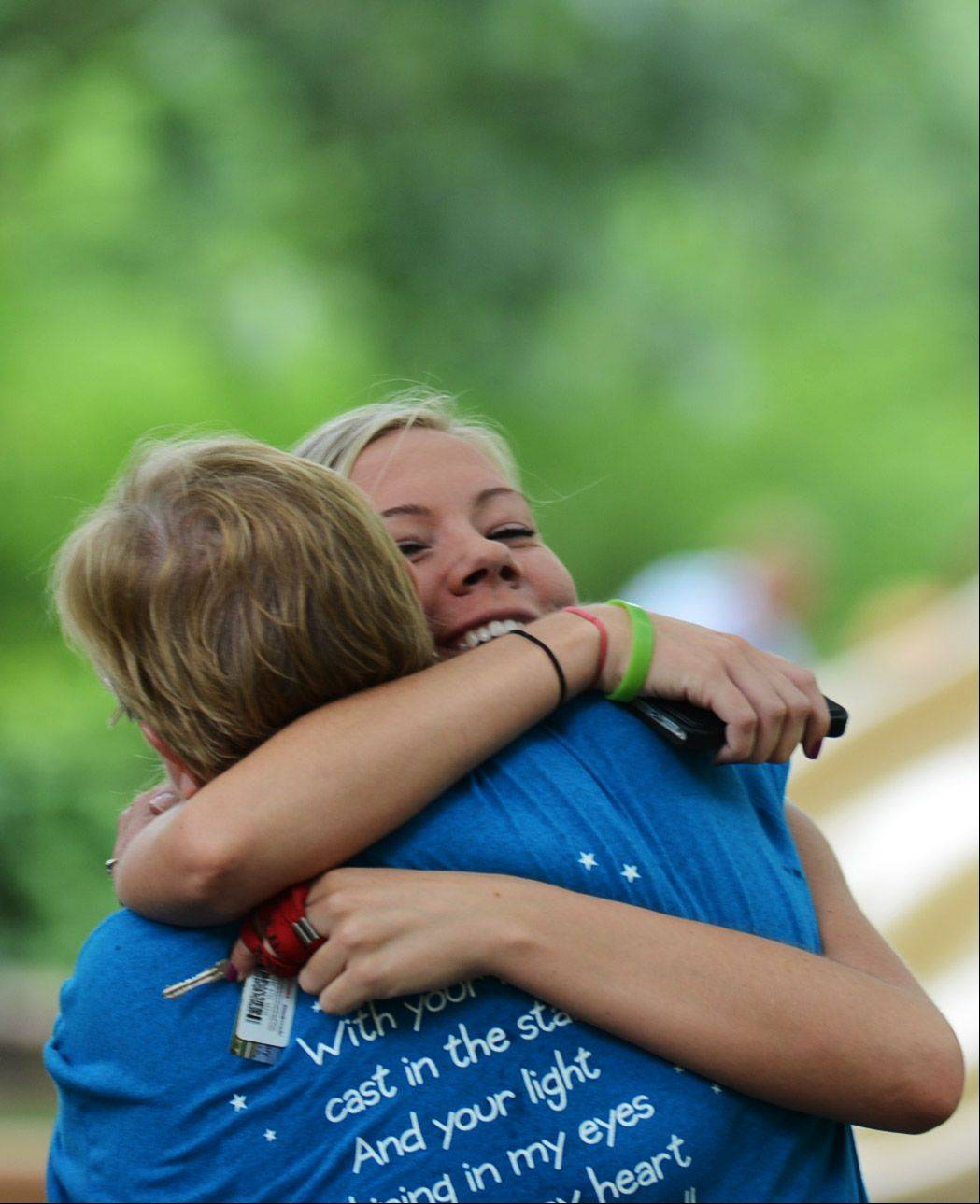 Mel Schlenker, 21, hugs Donna Mebane, mother of Emma Mebane, 19, who passed away suddenly in 2011. The Emma Memorial Mini-Golf Tournament at Stone Creek course took place Sunday at Wheeler Park in Geneva and allowed for family and friends to gather in remembrance of Emma. Mebane and Schlenker are both from Geneva.