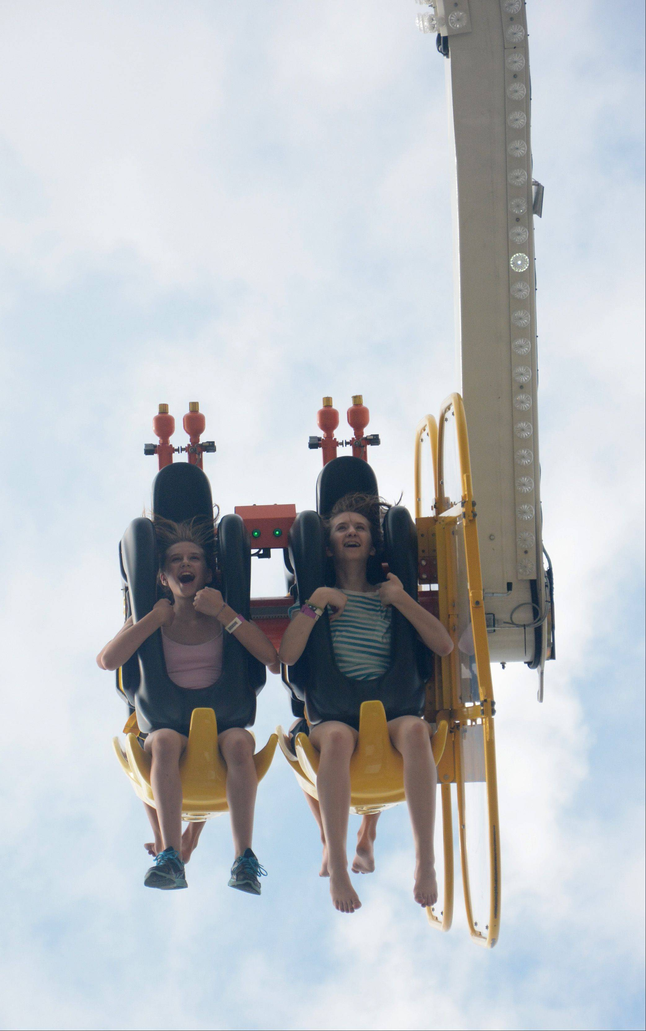 Lindsey Savage, left, and sister Karenna ride Speed during the final day of Arlington Heights' Frontier Days on Sunday.