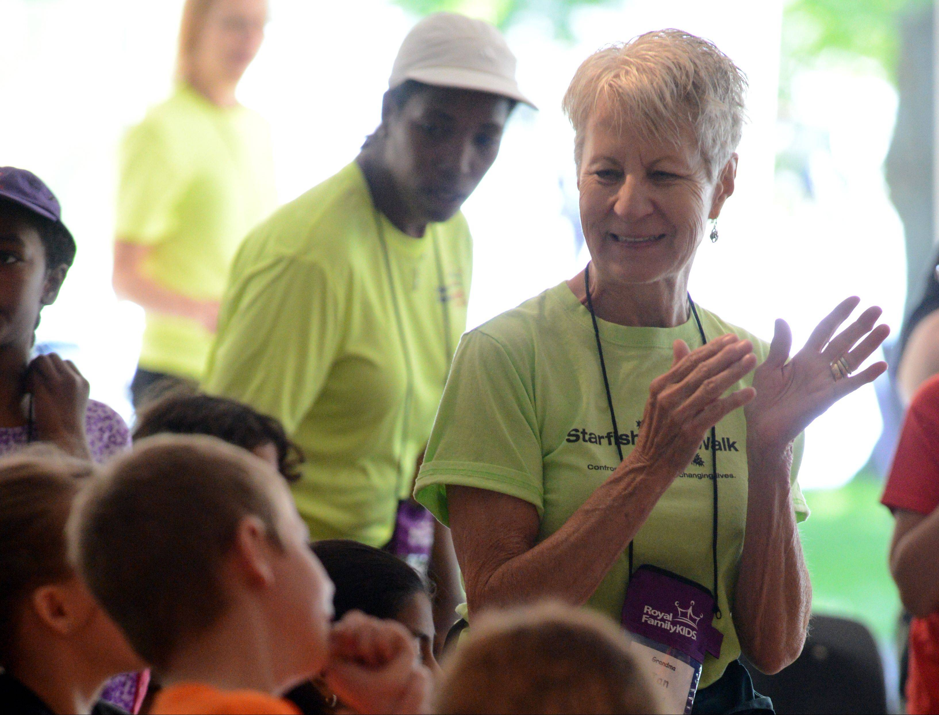 Jan Krueger of Batavia sings with campers during their chapel time at a Royal Family Kids Camp. Jan and her late husband Bill founded the camp 10 years ago. The camp is for kids ages 7 to 11 who are in the DCFS system.