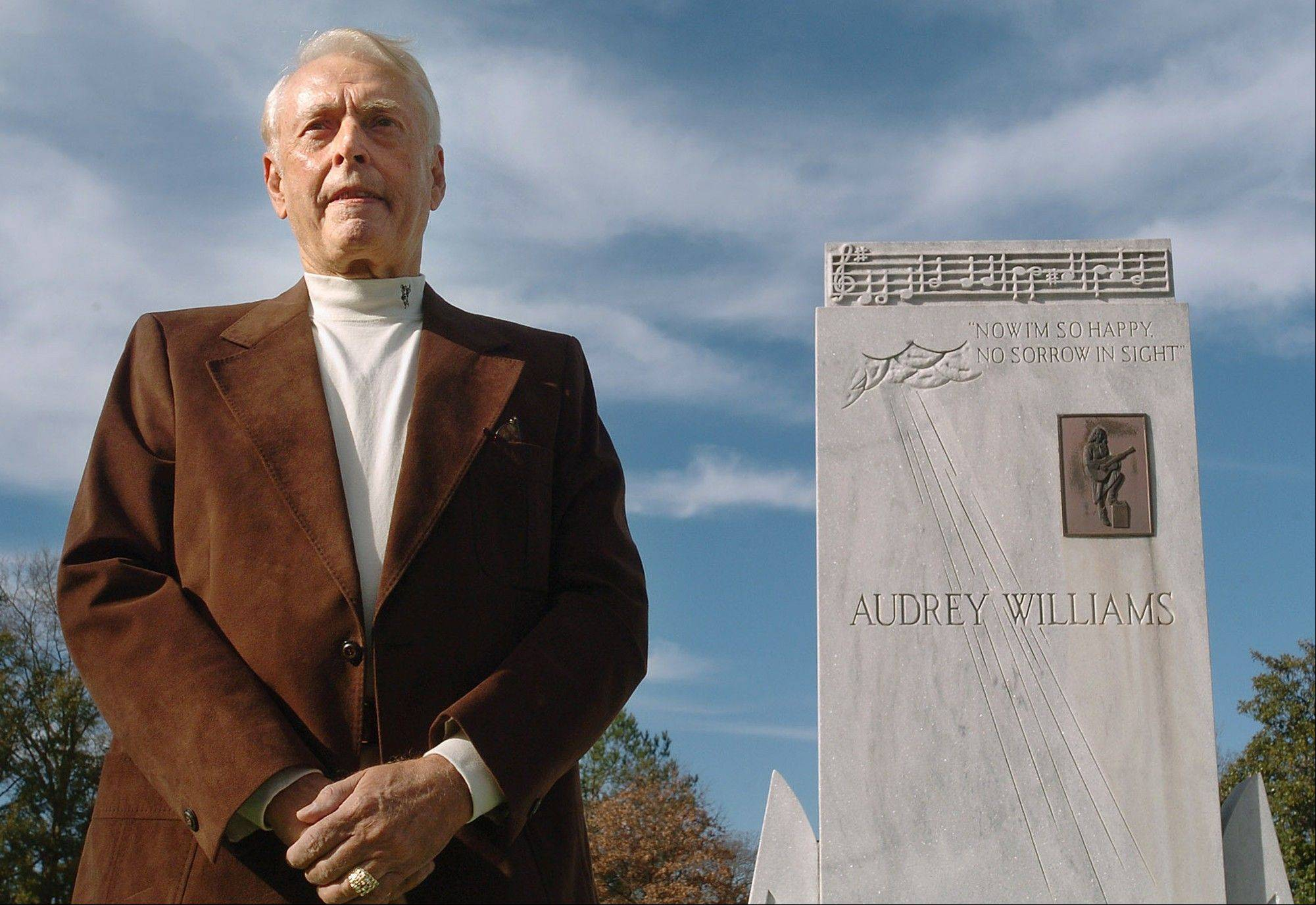 Charles Carr is shown at the graves of Hank and Audrey Williams in Oakwood Cemetery in Montgomery, Ala. in this Monday, Jan. 1, 2007, photo. Carr died on Monday, July 1, 2013, after a brief illness. He was 77. Carr was driving Hank Williams through Oak Hill, W. Va., when Williams died on New Year's Day in 1953.