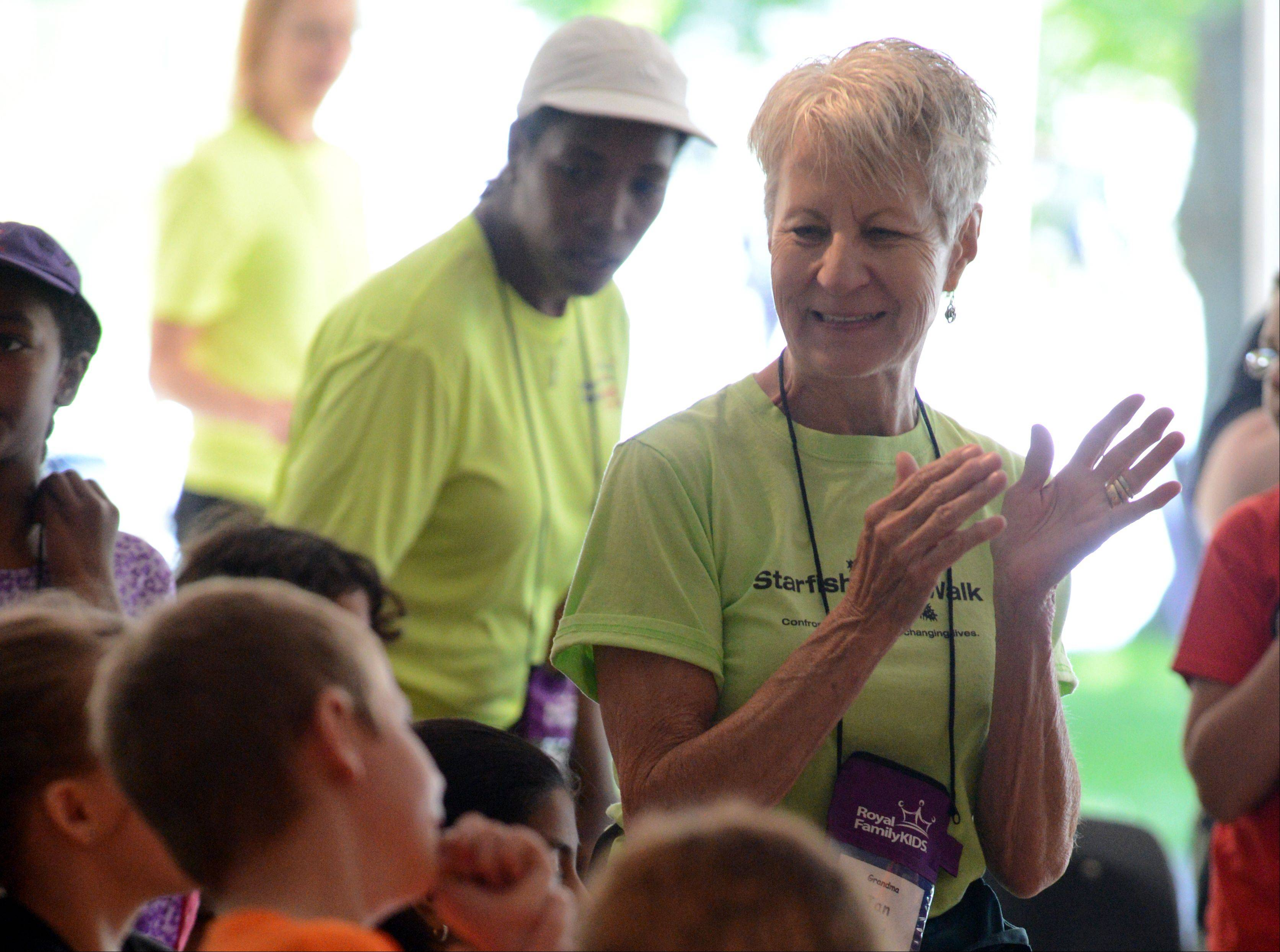 Jan Krueger of Batavia sings with campers during their chapel time at the camp in Wisconsin. Jan and her late husband Bill founded the Geneva Royal Family Kids Camp 10 years ago. The camp is for kids ages 7 to 11 who are in DCFS system. The Geneva group has also started camps for middle school and high school aged kids that have aged out of the earlier camps.