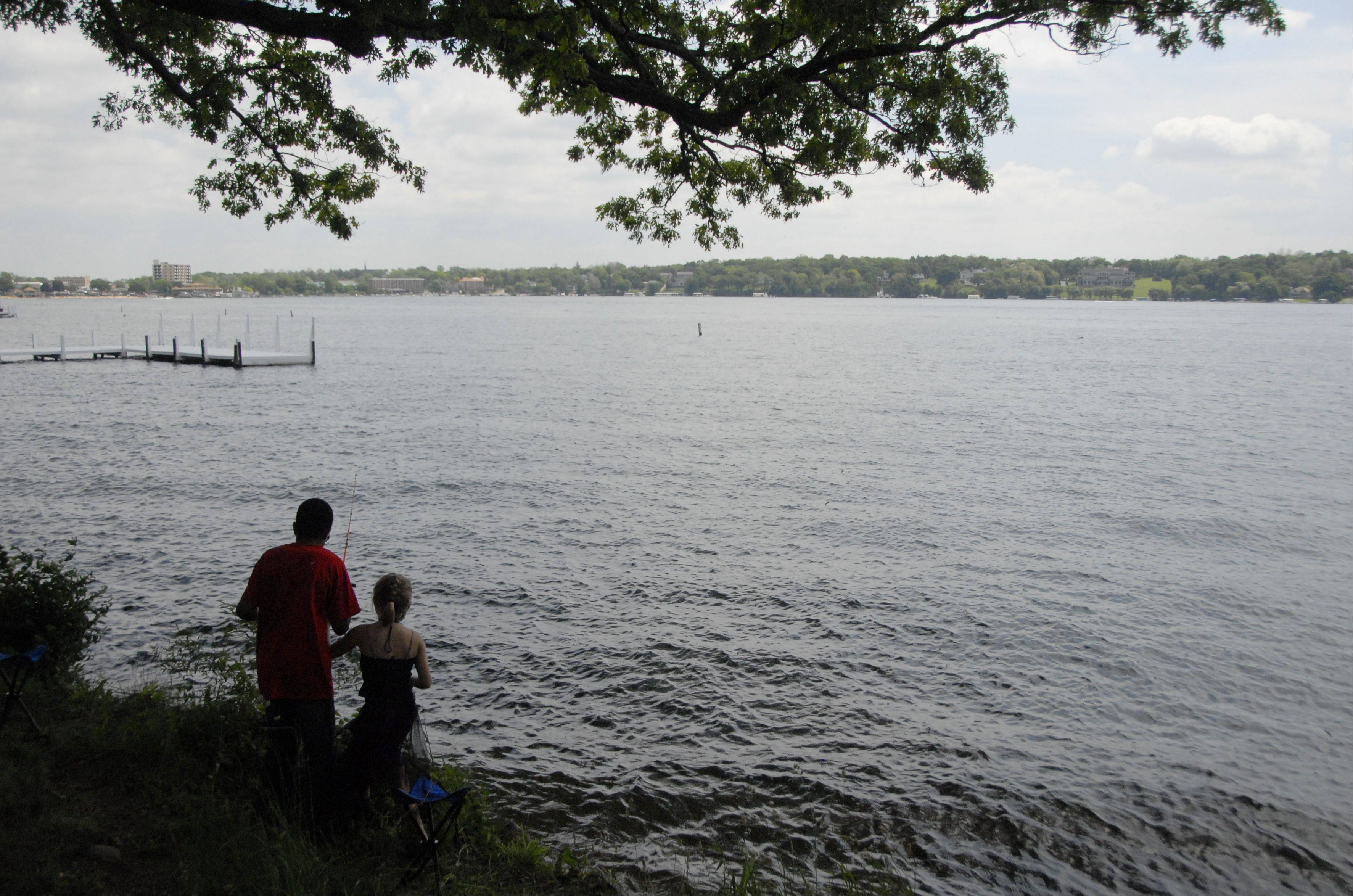 Royal Family Kids Camp campers fish along the lake at their camp in Wisconsin.