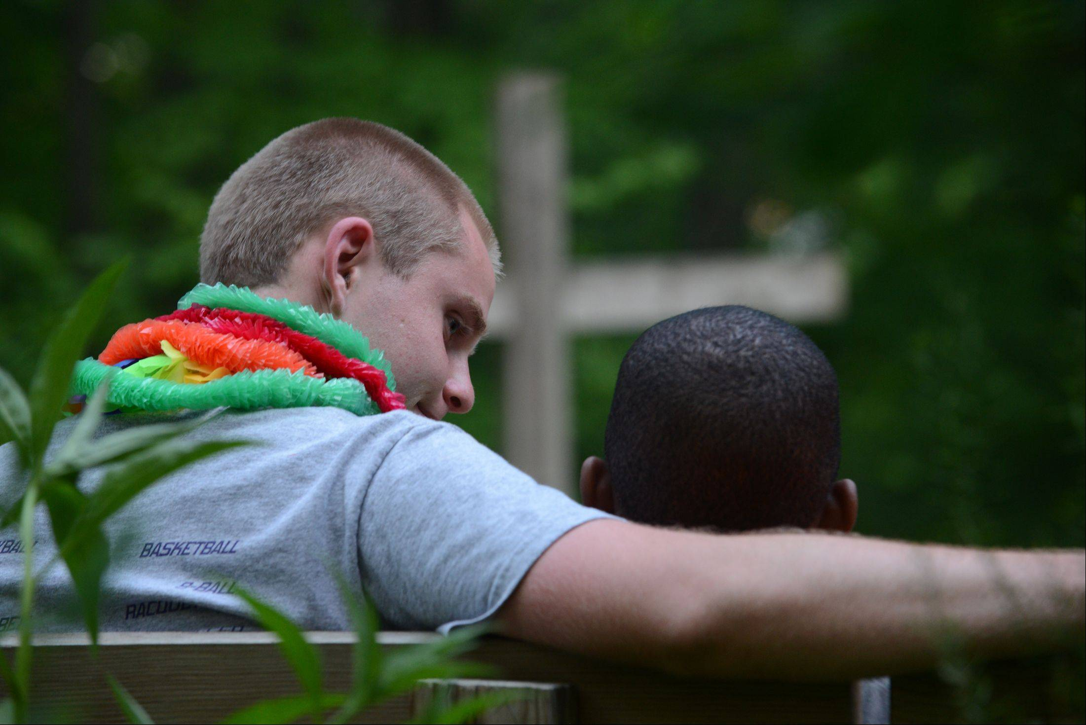 Royal Family Kids Camp counselor Tom Ward shares a quiet moment with his camper during the camp fire that ends each day at camp.
