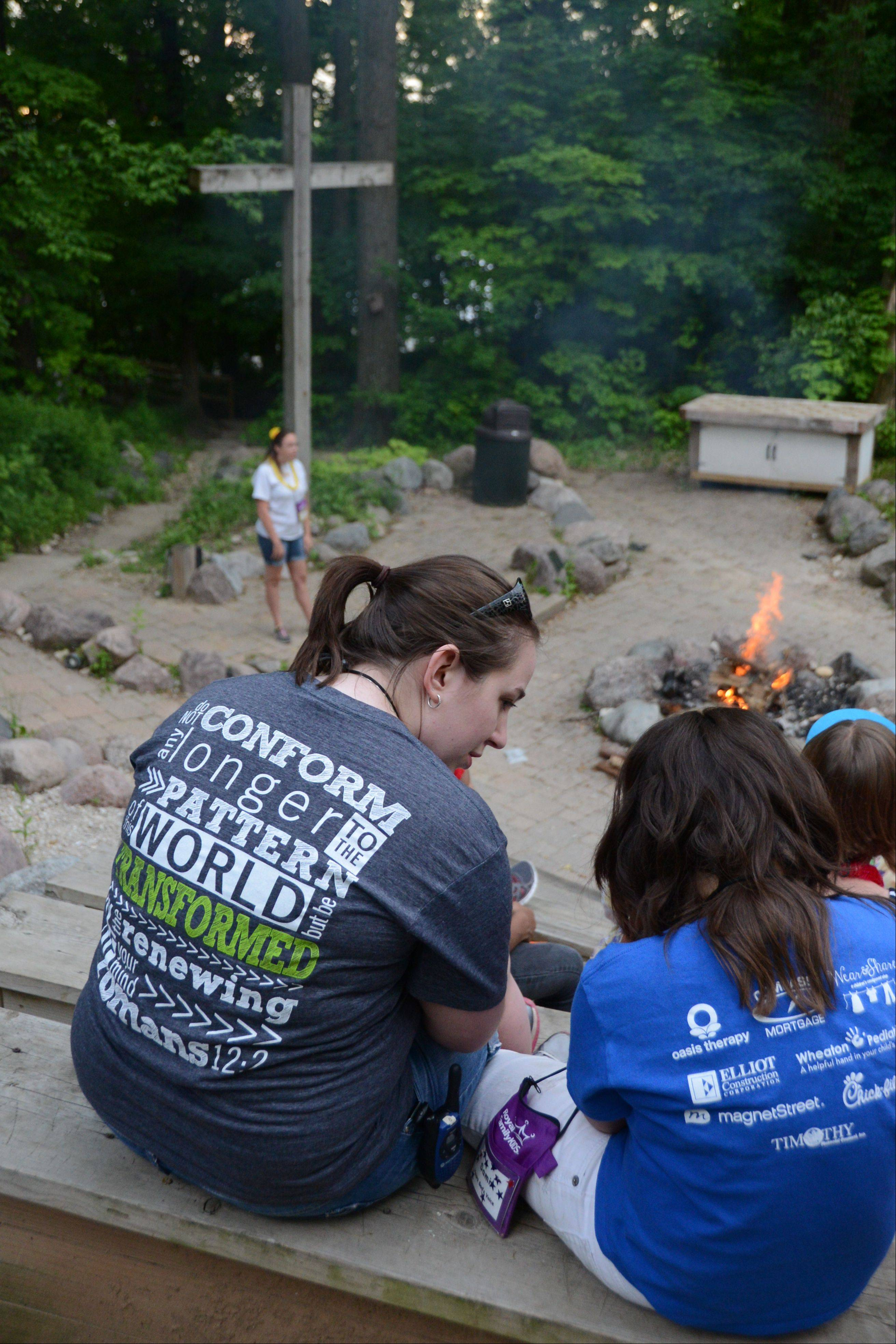 Royal Family Kids Camp counselors and campers at the camp fire that ends each day.