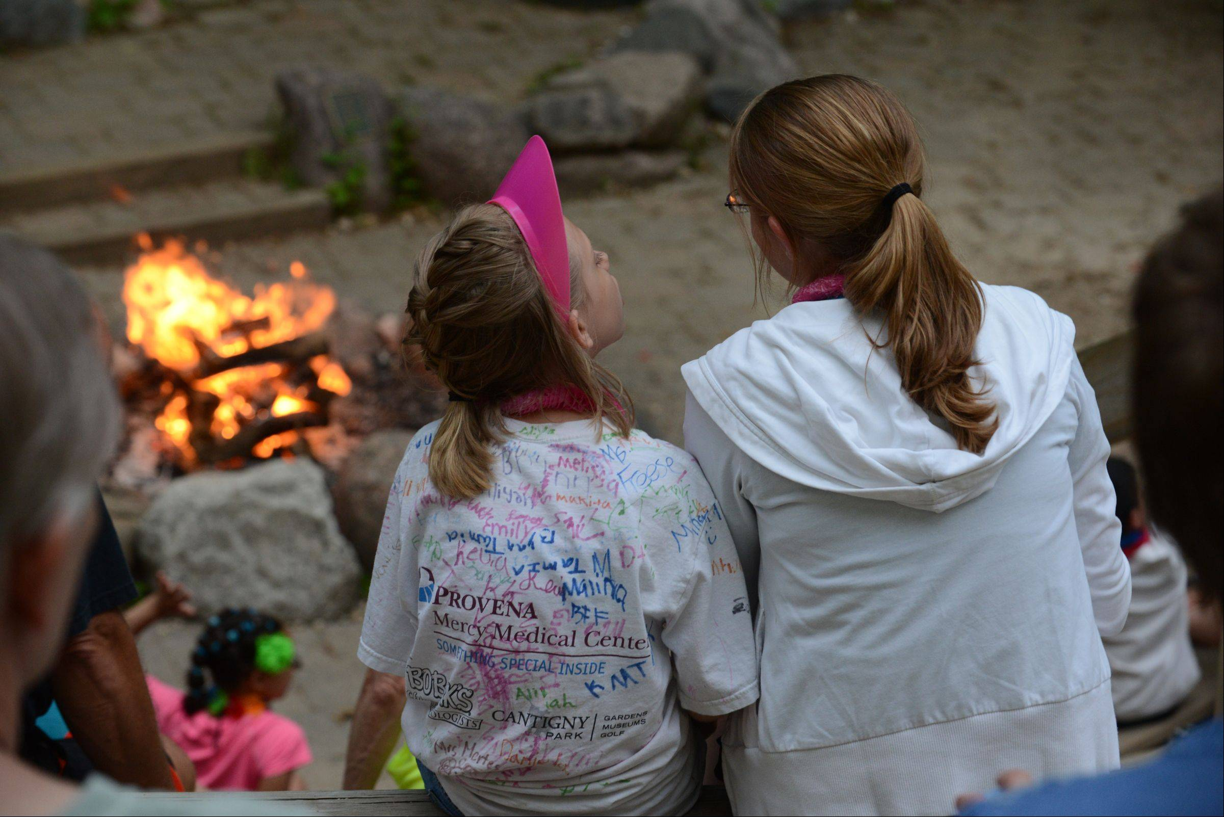 Royal Family Kids Camp counselors and campers at the camp fire that ends each day at camp.