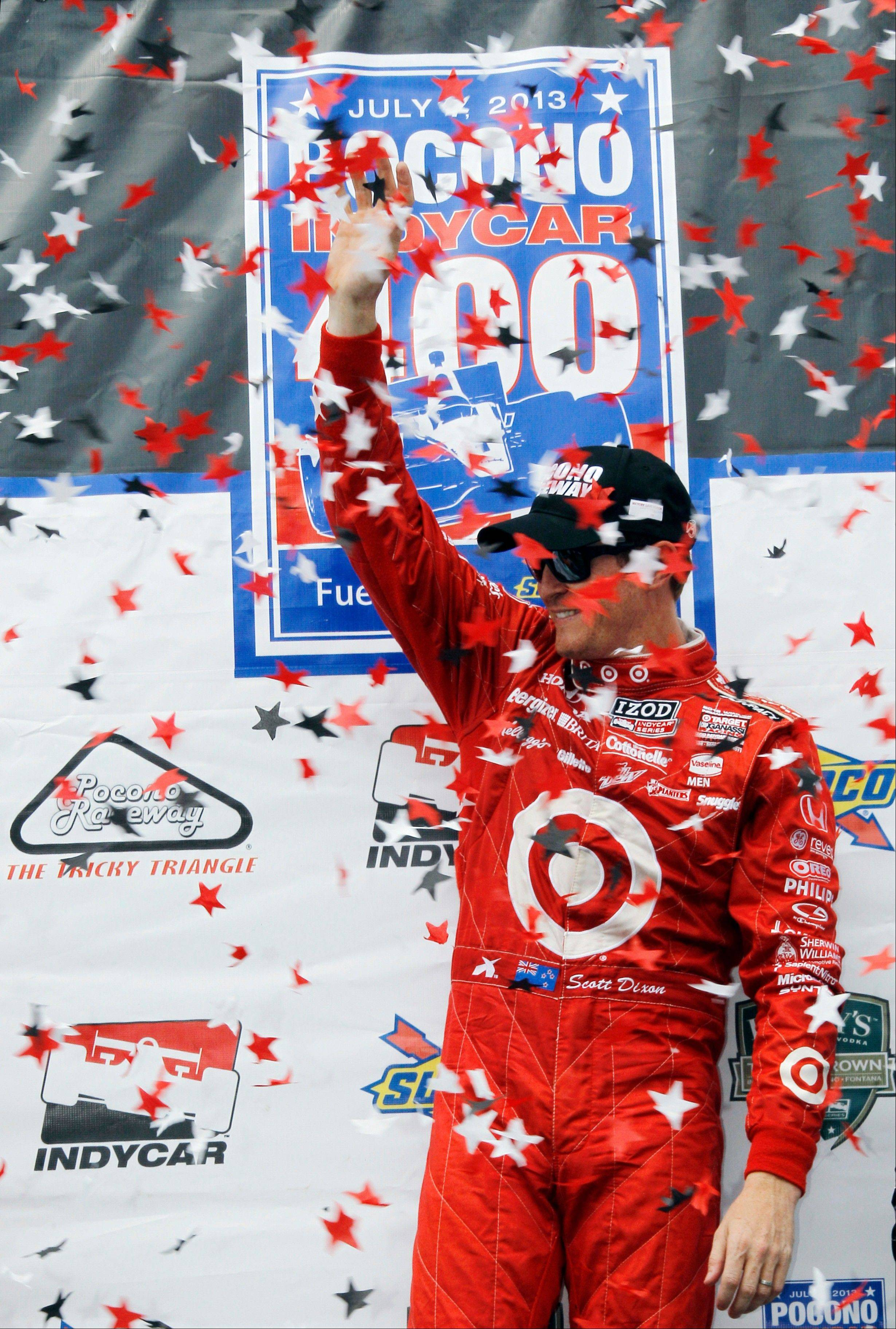 Scott Dixon waves from Victory Lane after winning the Pocono IndyCar 400 auto race on Sunday in Long Pond, Pa.