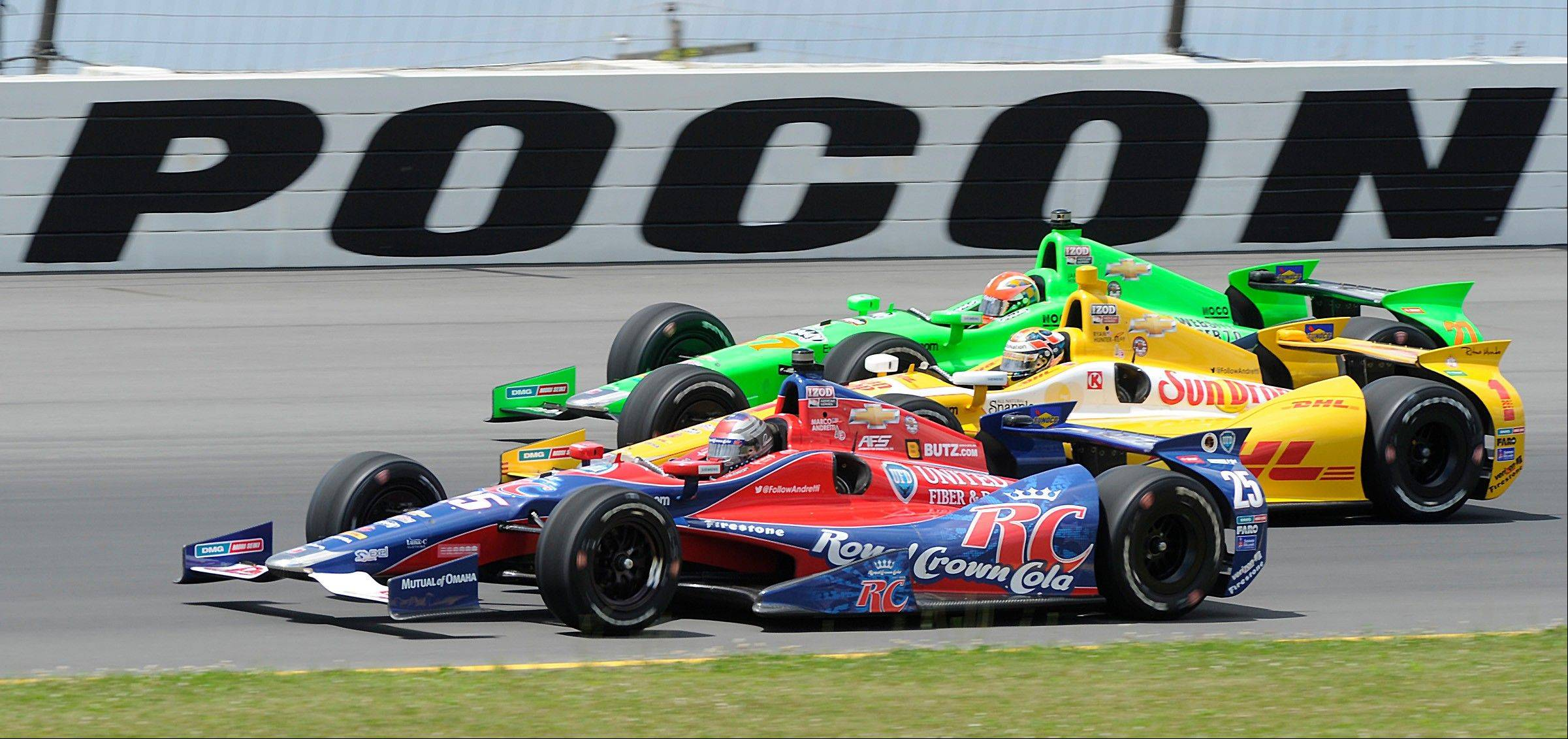 Marco Andretti (25), Ryan Hunter-Reay (1) and James Hinchcliffe (27) drive through Turn 3 as they head for the green flag to start the IndyCar Pocono 400 auto race Sunday in Long Pond, Pa. Hinchcliffe hit the wall not long after the green flag, Hunter-Reay got in a freak pit-road accident, and Andretti faded from contention as his fuel ran low late in the race.