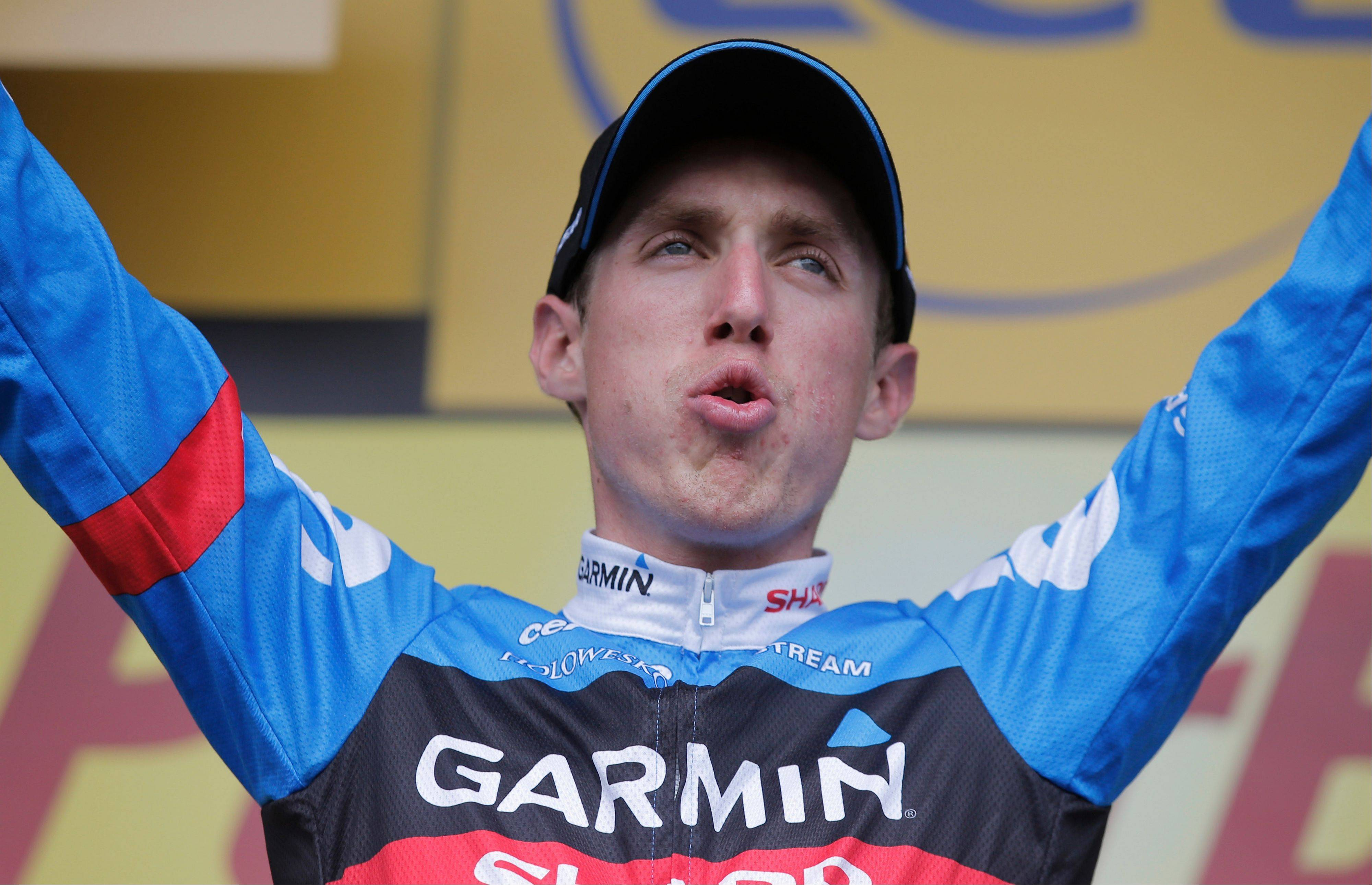 Daniel Martin of Ireland celebrates on the podium after the ninth stage of the Tour de France on Sunday.