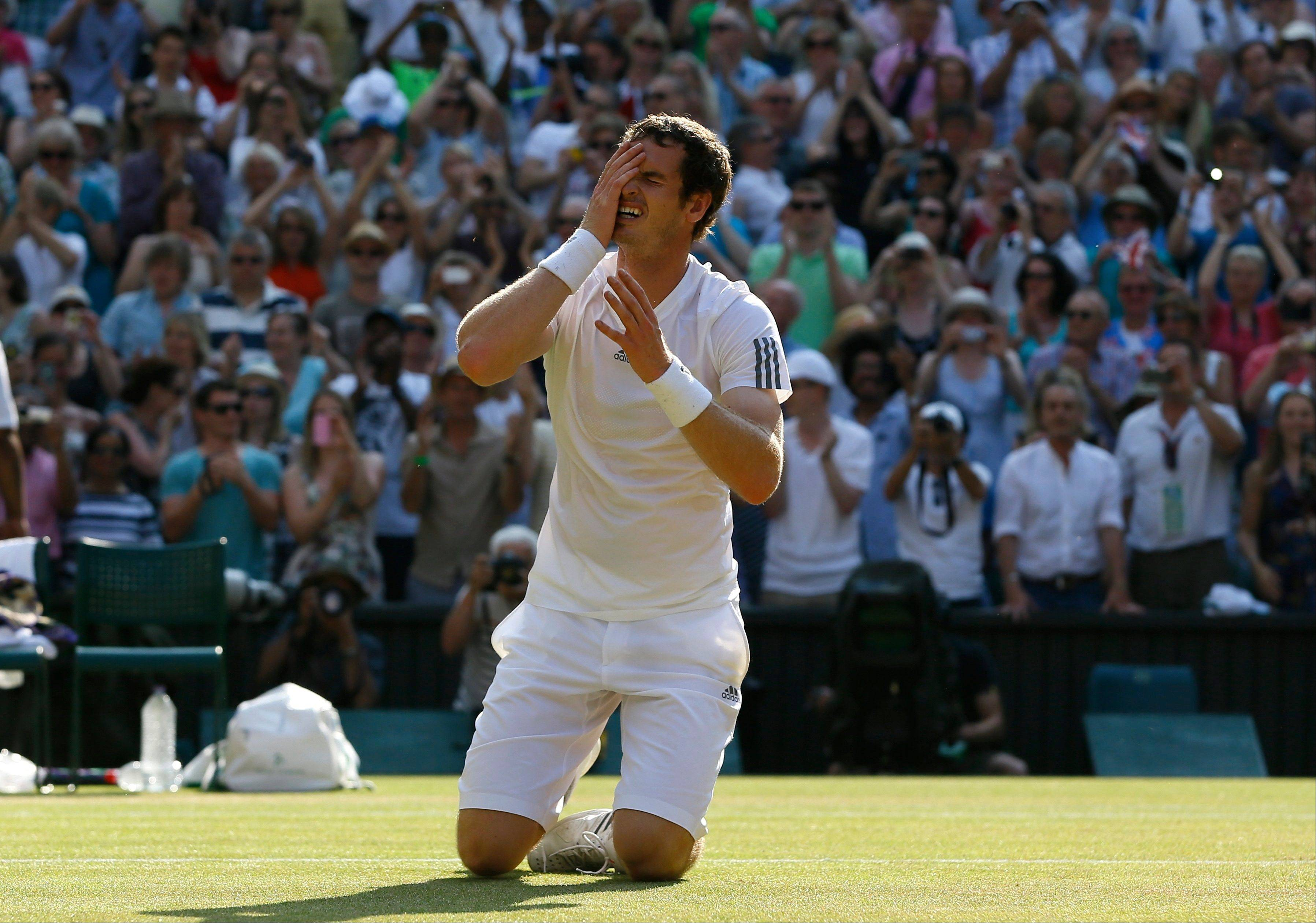 Andy Murray of Britain reacts after winning against Novak Djokovic of Serbia in the Men's singles final match at the All England Lawn Tennis Championships in Wimbledon, London, Sunday, July 7, 2013.