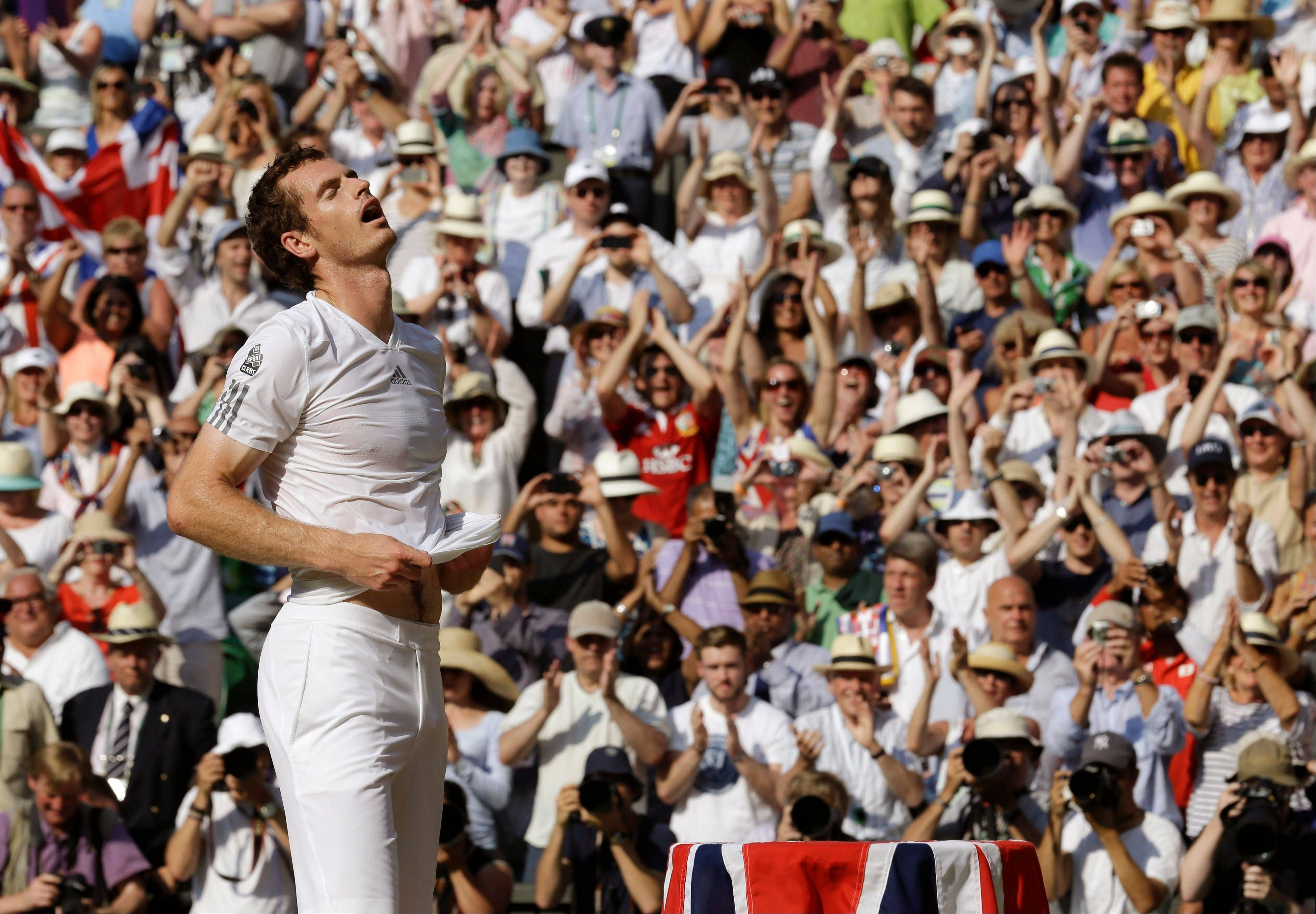 Andy Murray of Britain reacts as he wins against Novak Djokovic of Serbia during the Men's singles final match at the All England Lawn Tennis Championships in Wimbledon, London, Sunday, July 7, 2013.