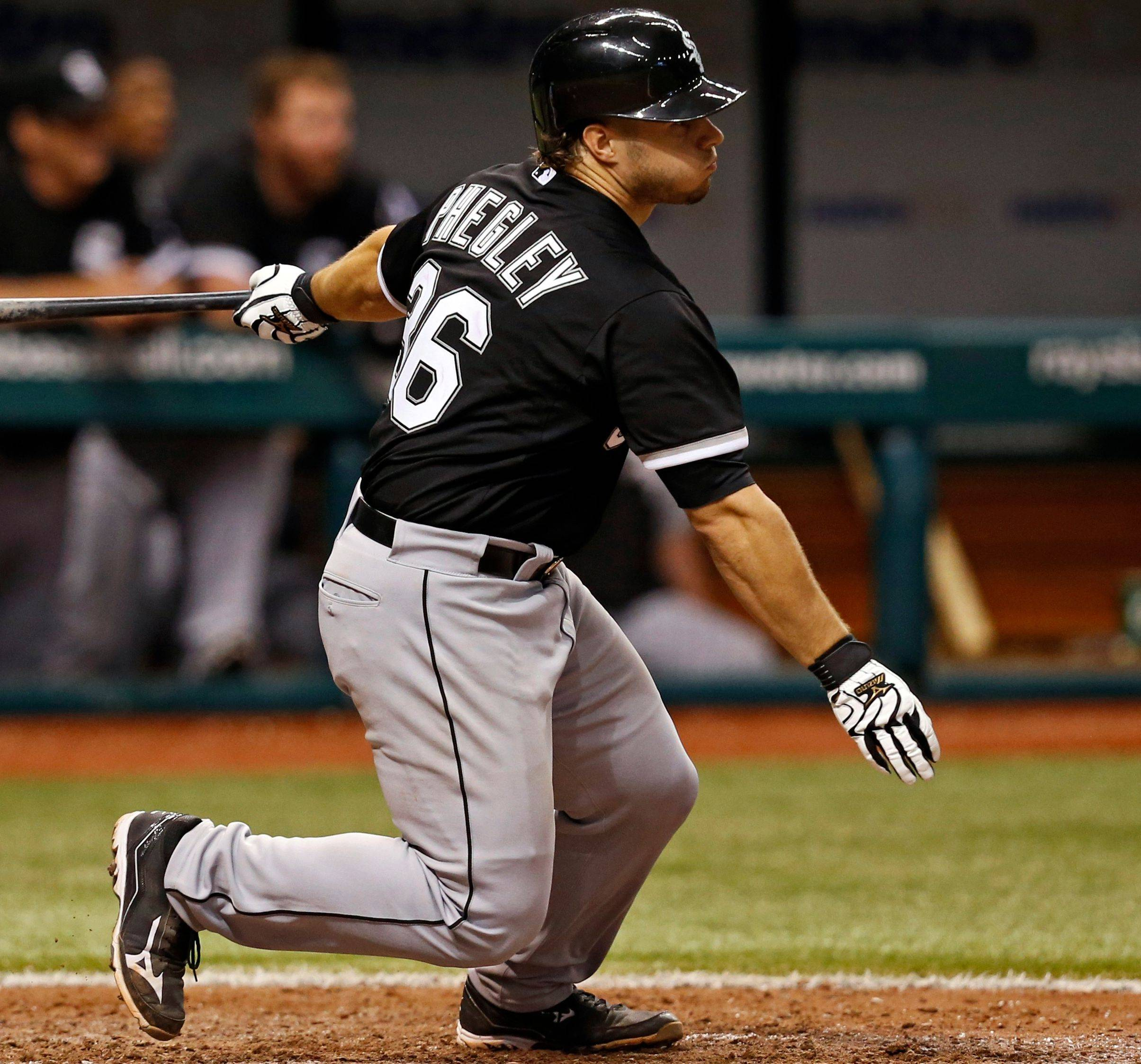 Josh Phegley follows through on a sacrifice fly during the White Sox' 8-3 loss to Tampa Bay on Friday. Phegley figures to split the catching duties with Tyler Flowers for the remainder of the season.